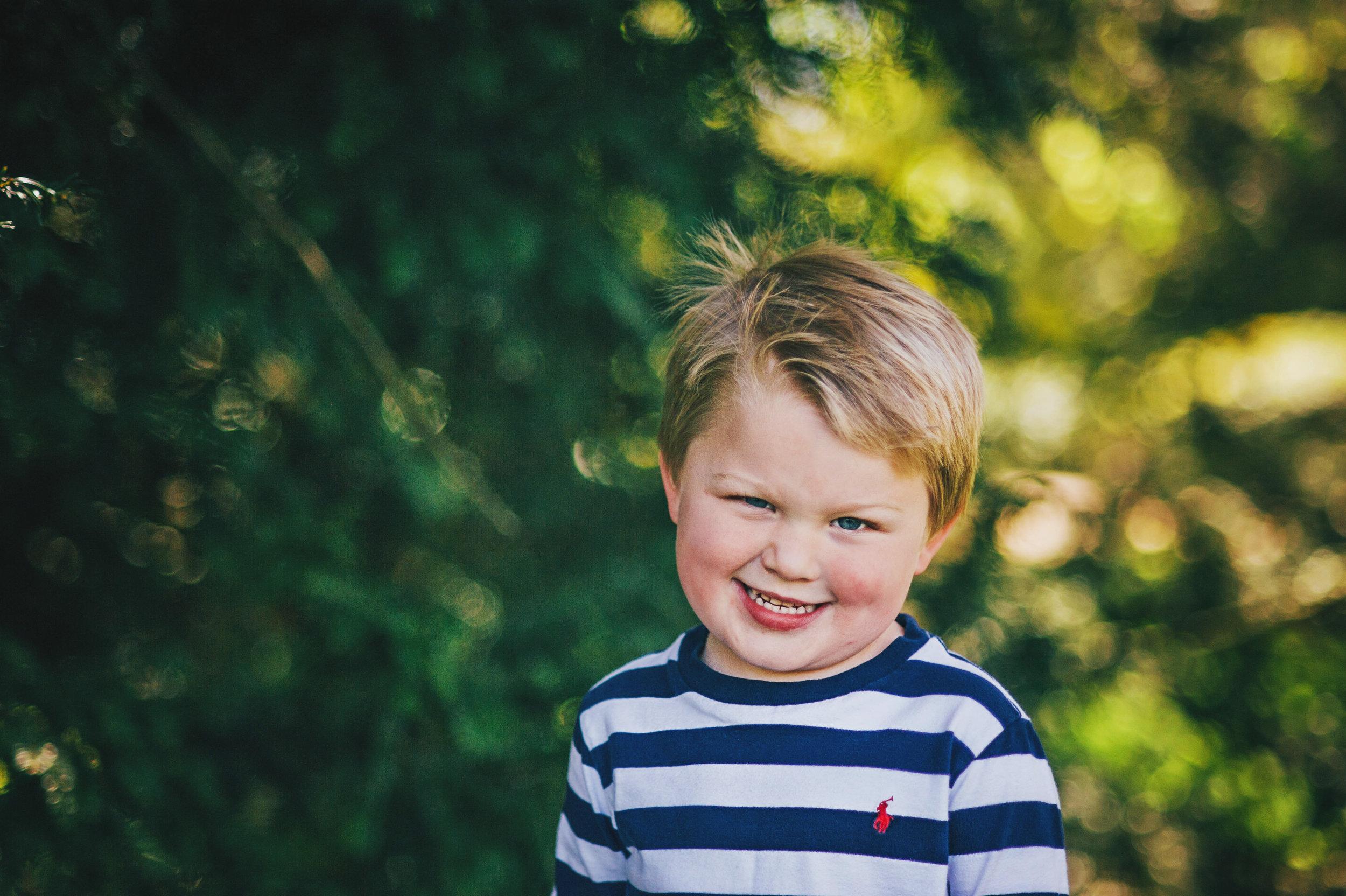 little boy in garden essex documentary portrait photographer