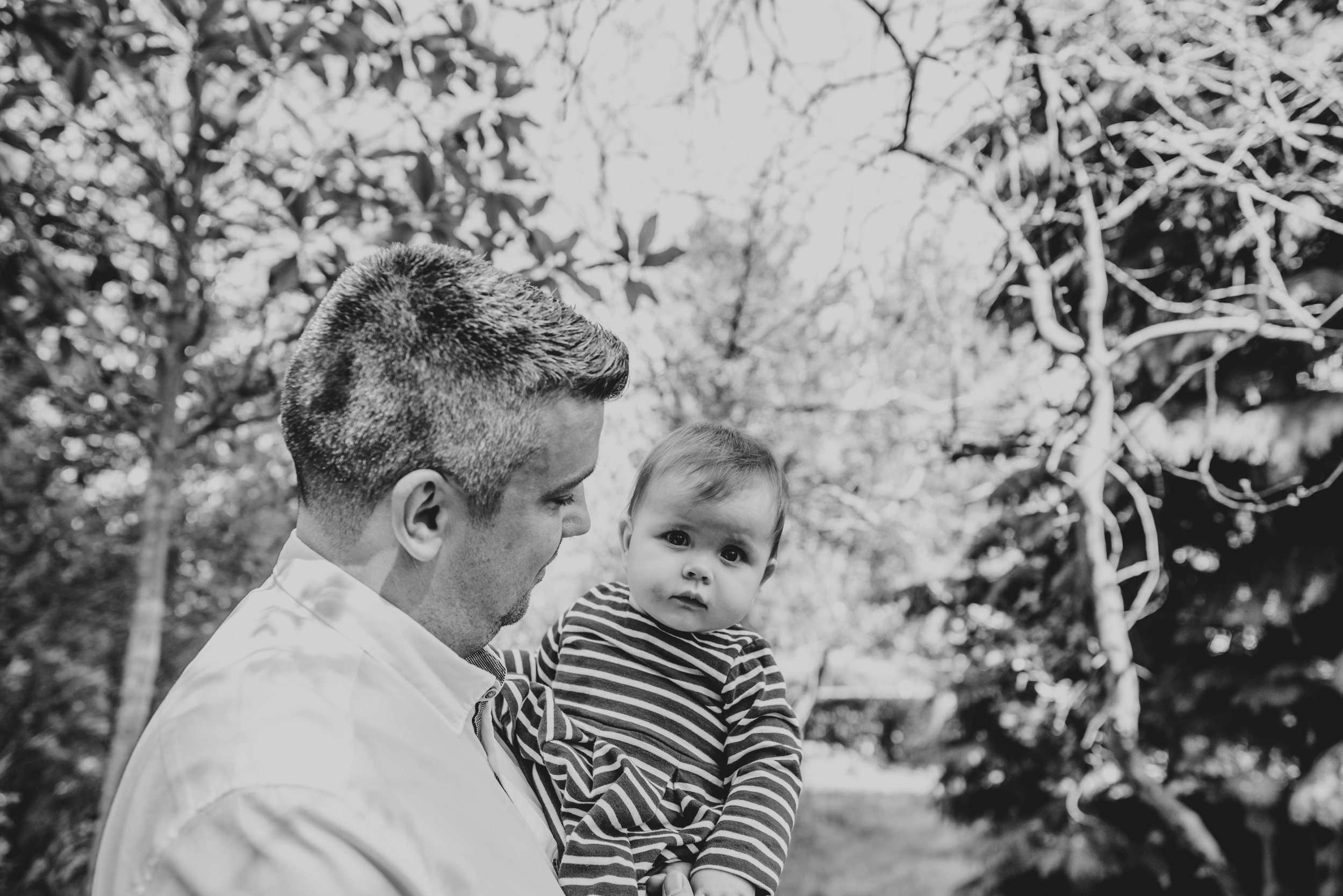 Dad with daughter in park in Spring Essex & London Documentary Family Photographer Lifestyle