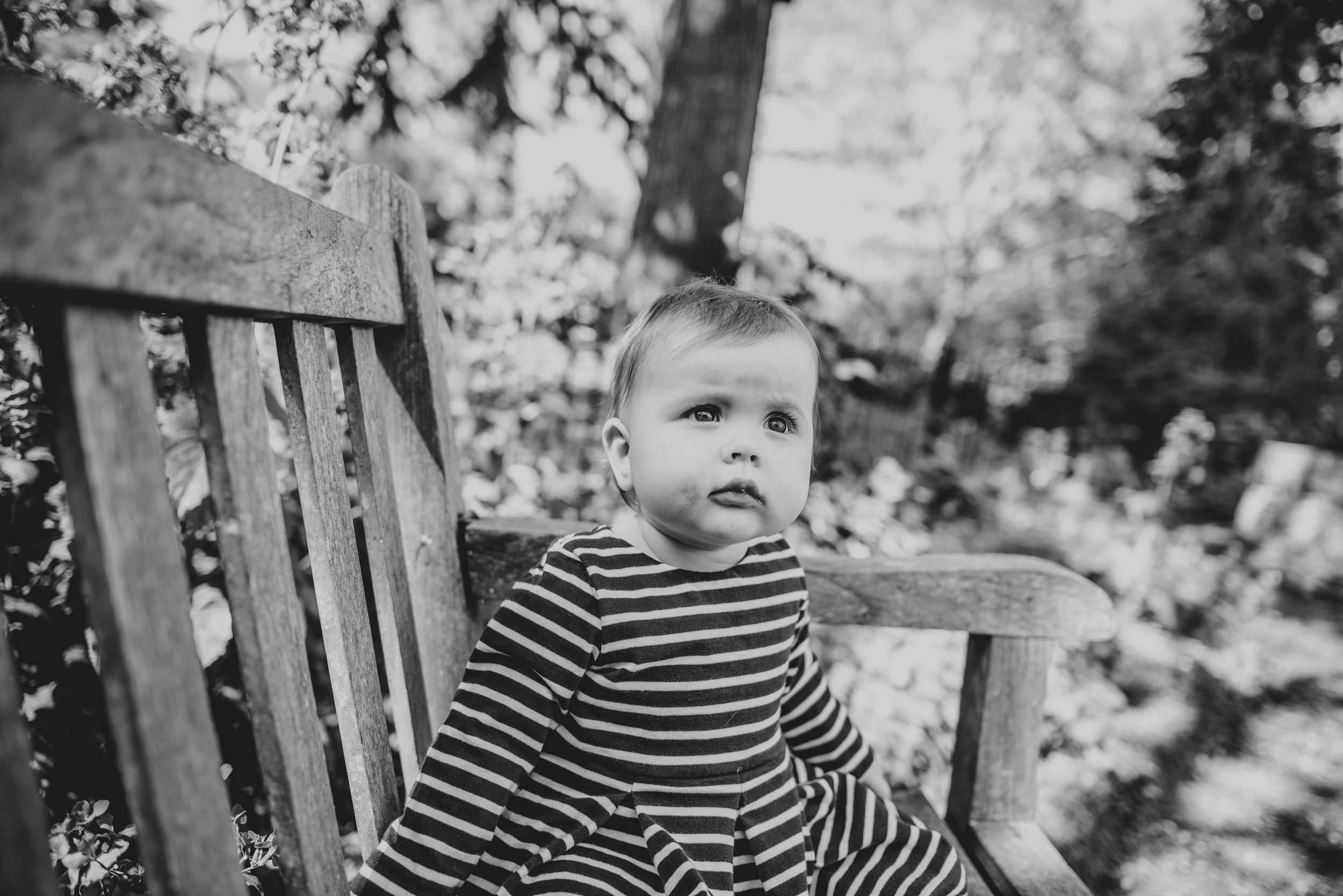 Baby girl on bench in park in Spring Essex & London Documentary Family Photographer Lifestyle