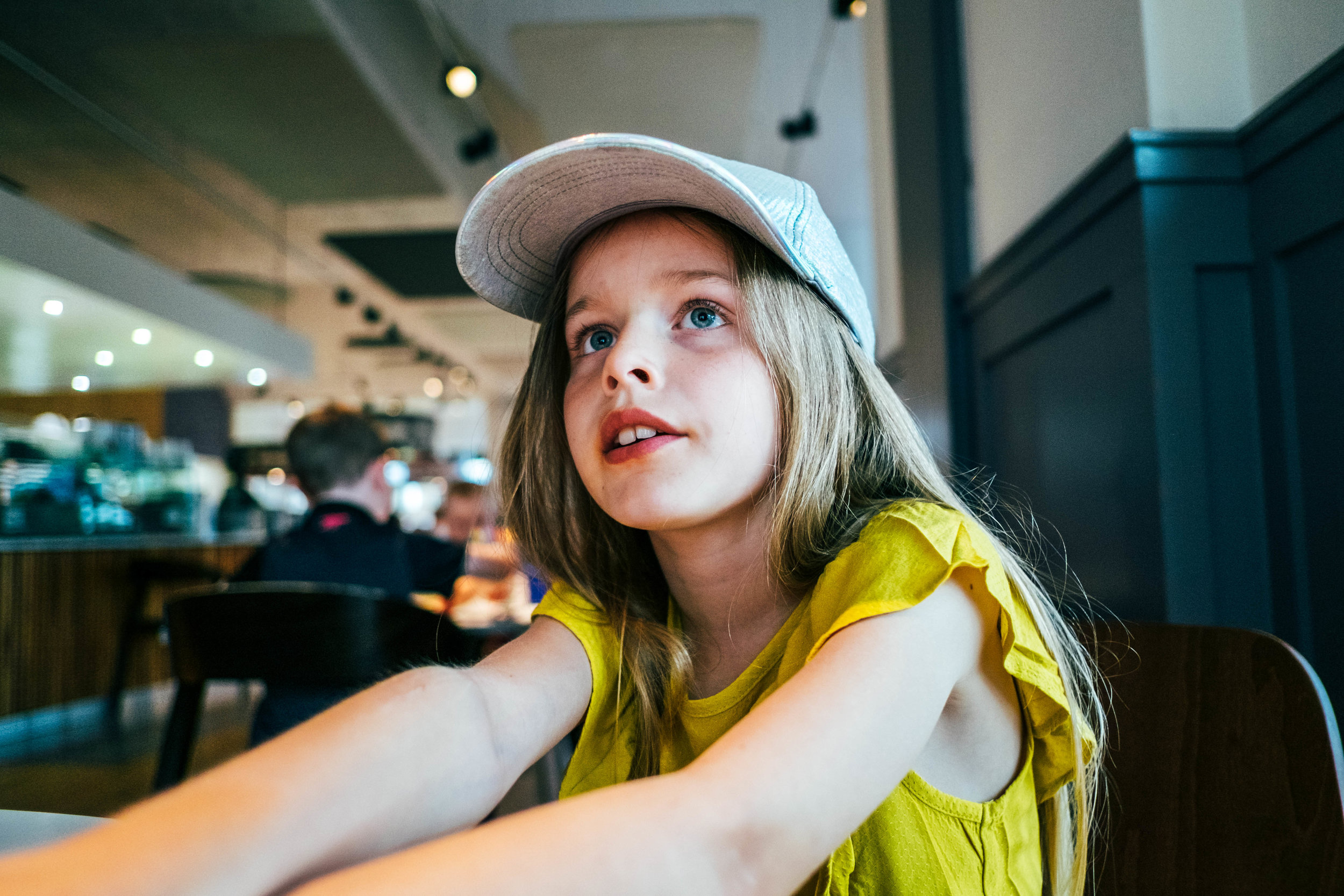 Little girl in cap Essex Family and Wedding Documentary Photographer