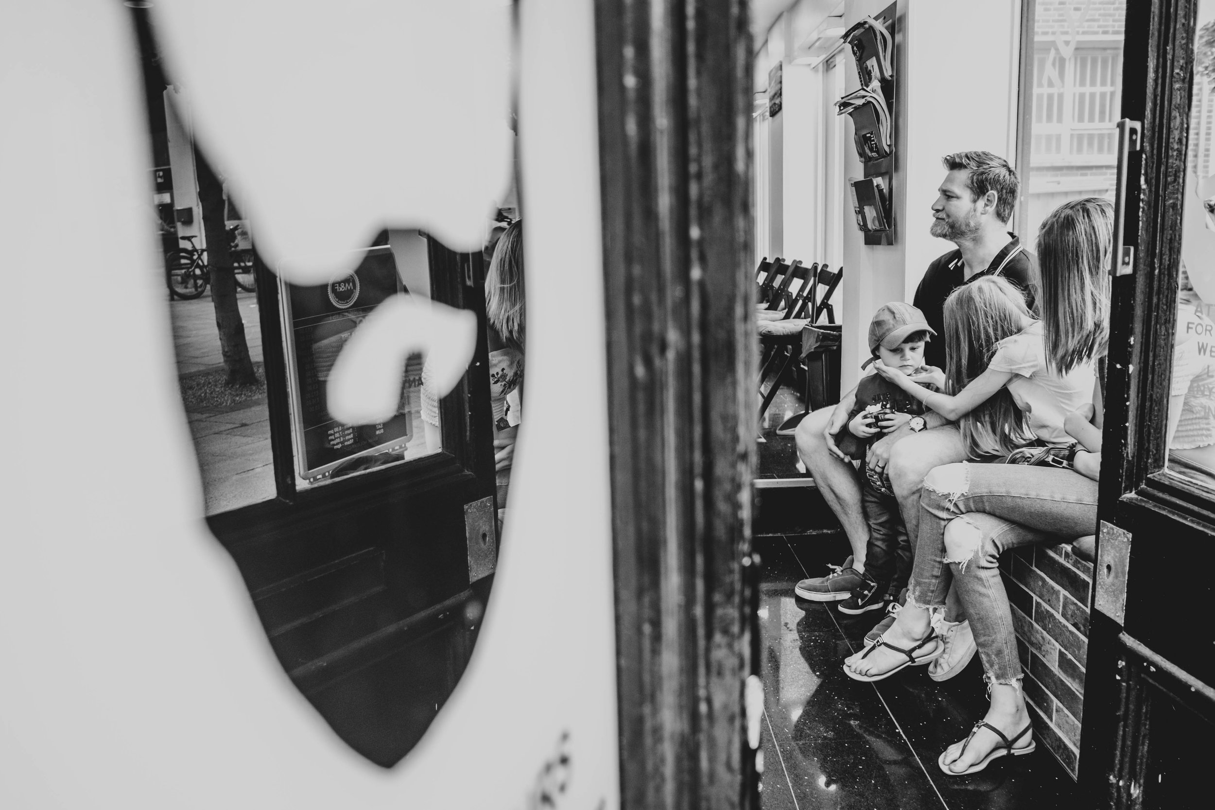 Family sit in barbers Essex Family and Wedding Documentary Photographer
