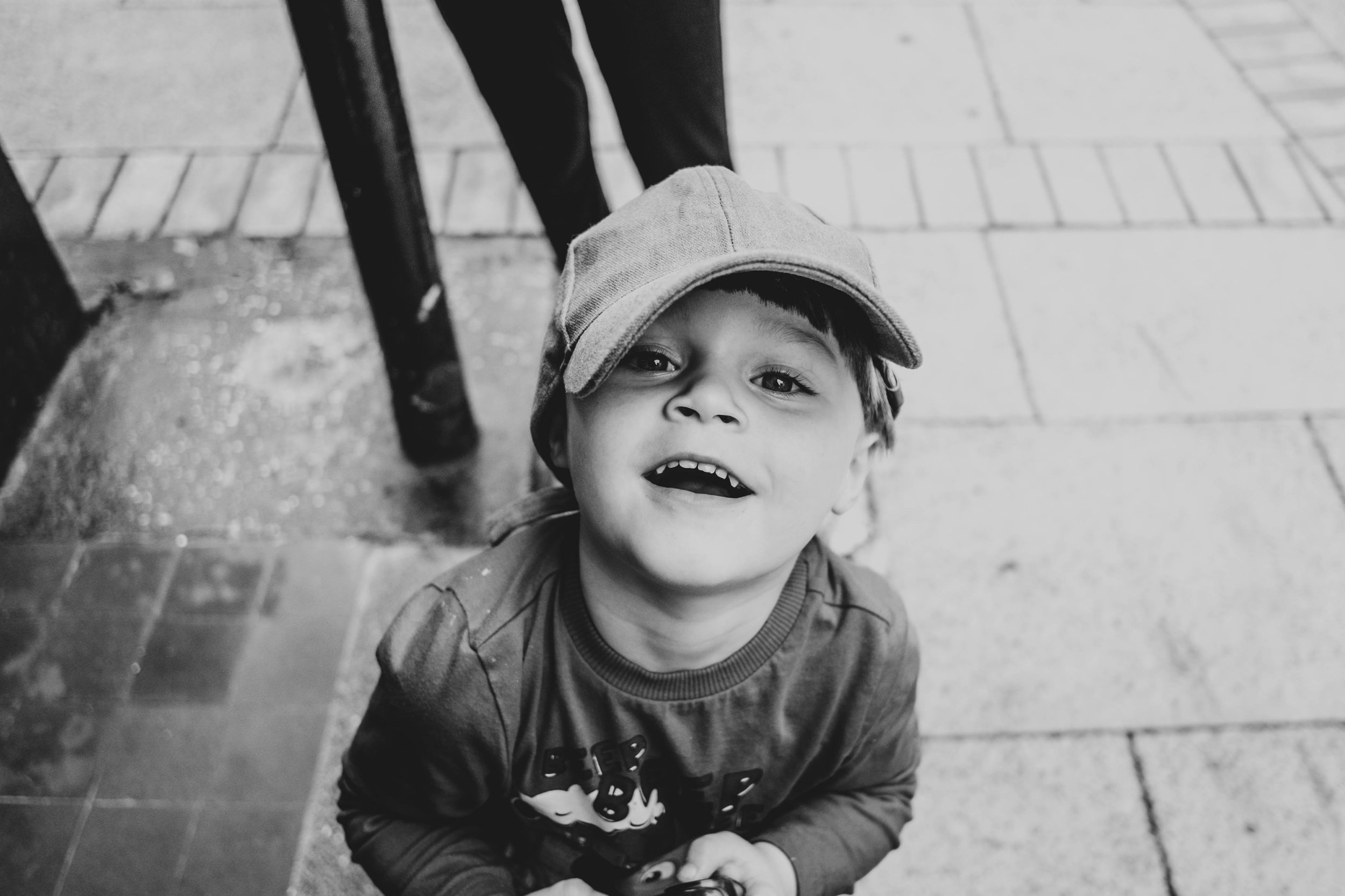 little boy in cap Essex Documentary Family and Wedding Photographer
