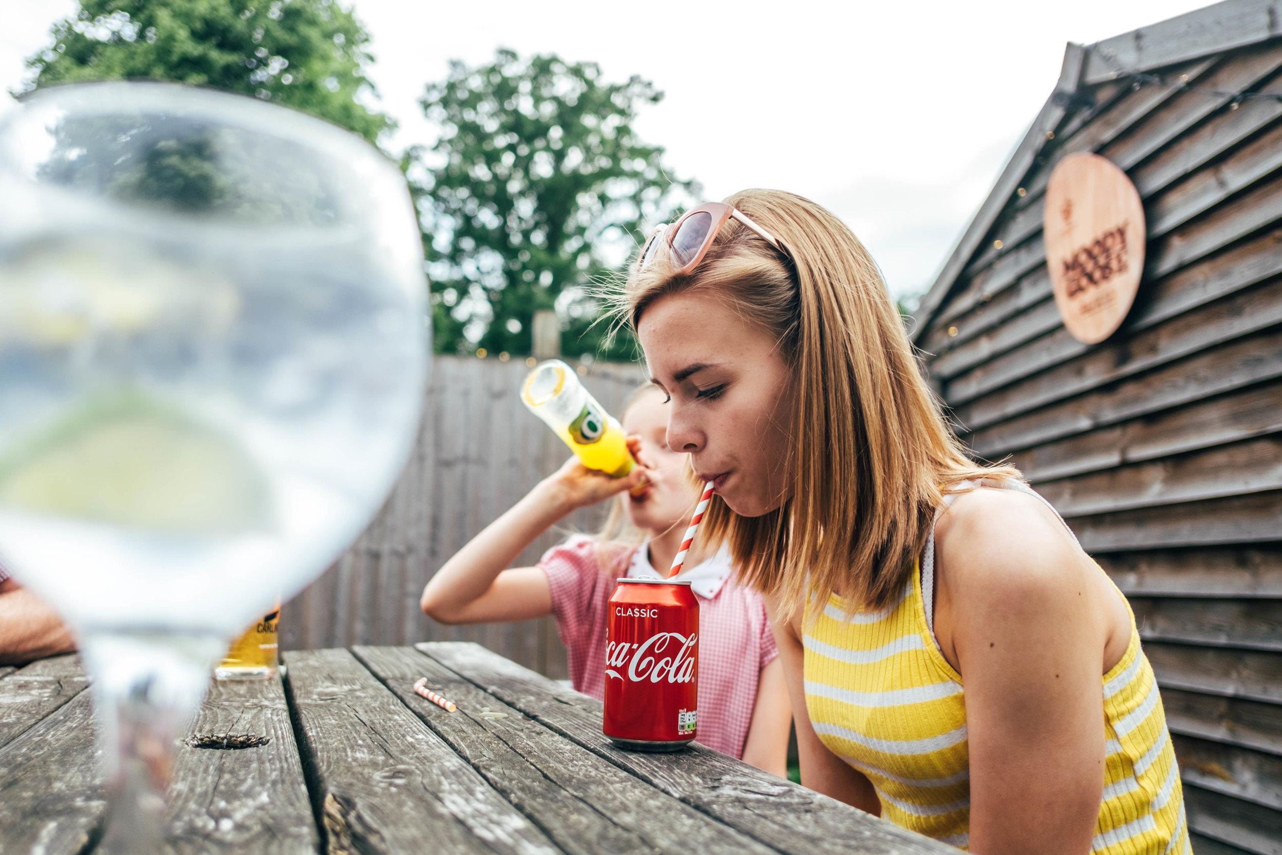 Teen girl drinks a coke Essex Family and Wedding Documentary Photographer