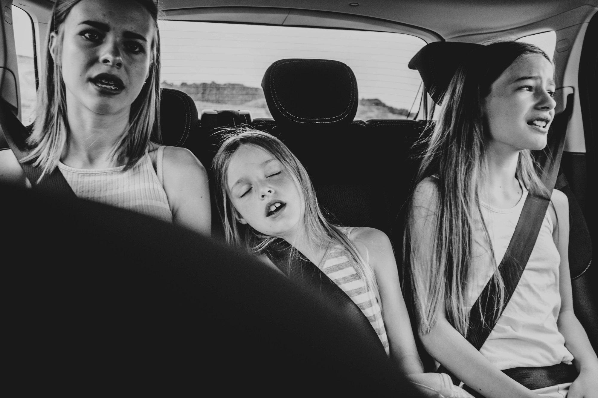 Little girl asleep in back of car Essex Documentary Wedding Travel Family Photographer