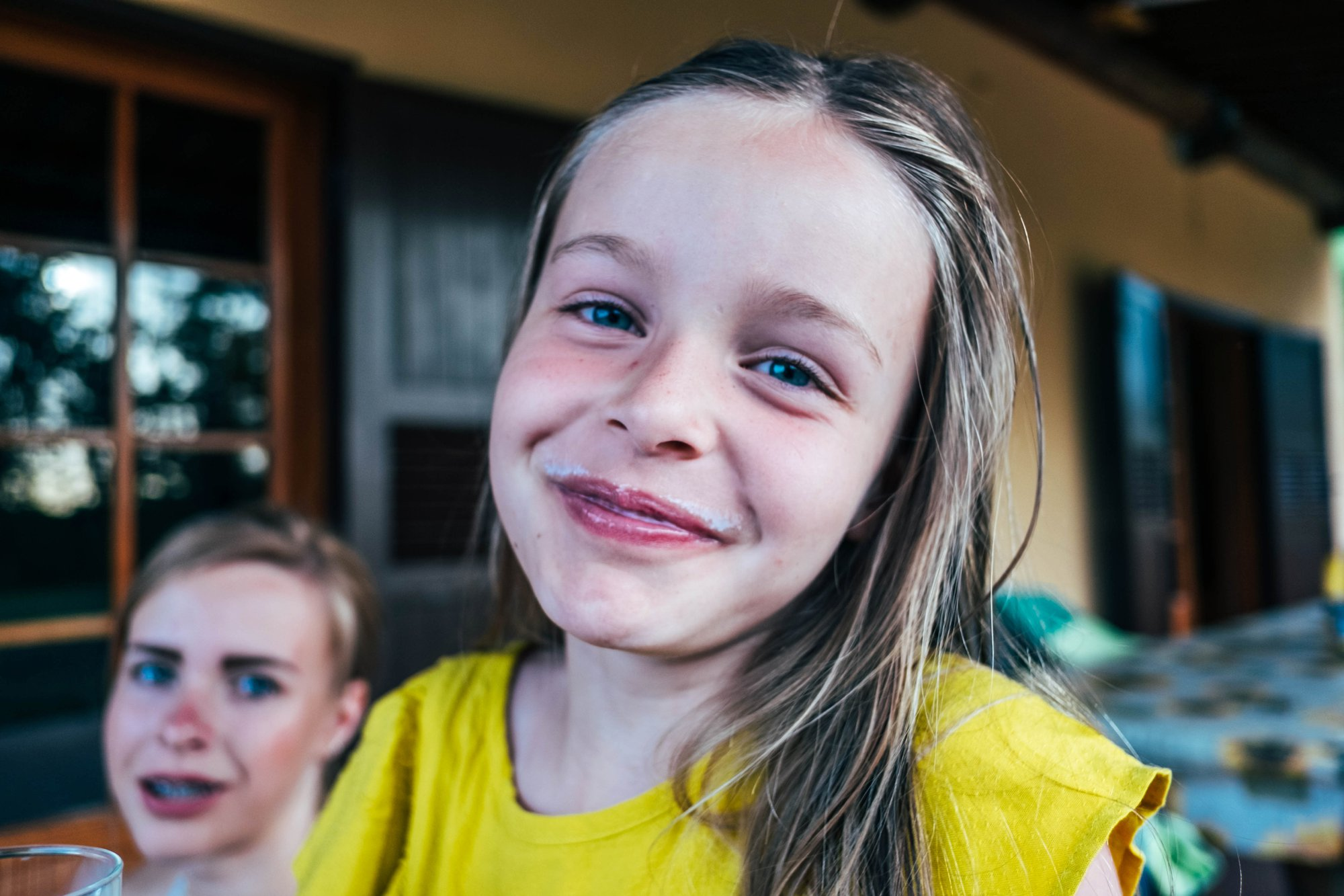 Little girl with milk moustache Essex Documentary Wedding Travel Family Photographer