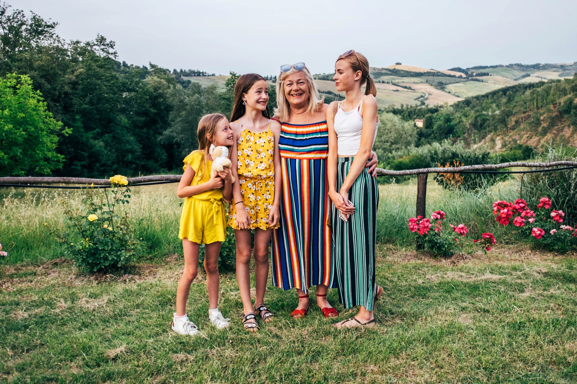 Grandmother with Grandaughters in Tuscan countryside Essex Documentary Wedding Travel Family Photographer