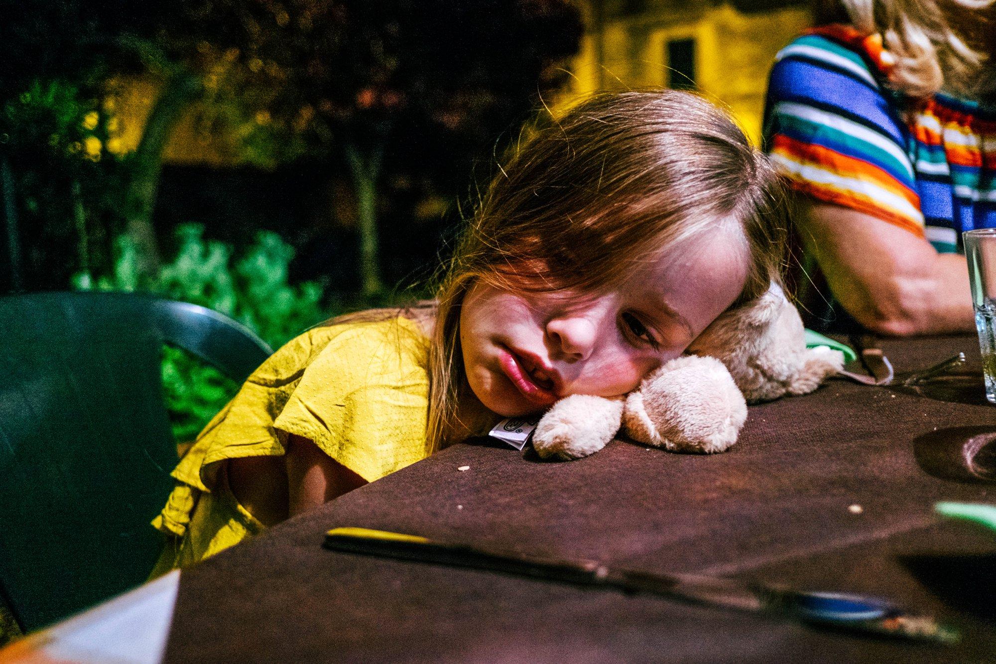 Little girl asleep at dinner table Essex Documentary Travel Wedding Family Photographer