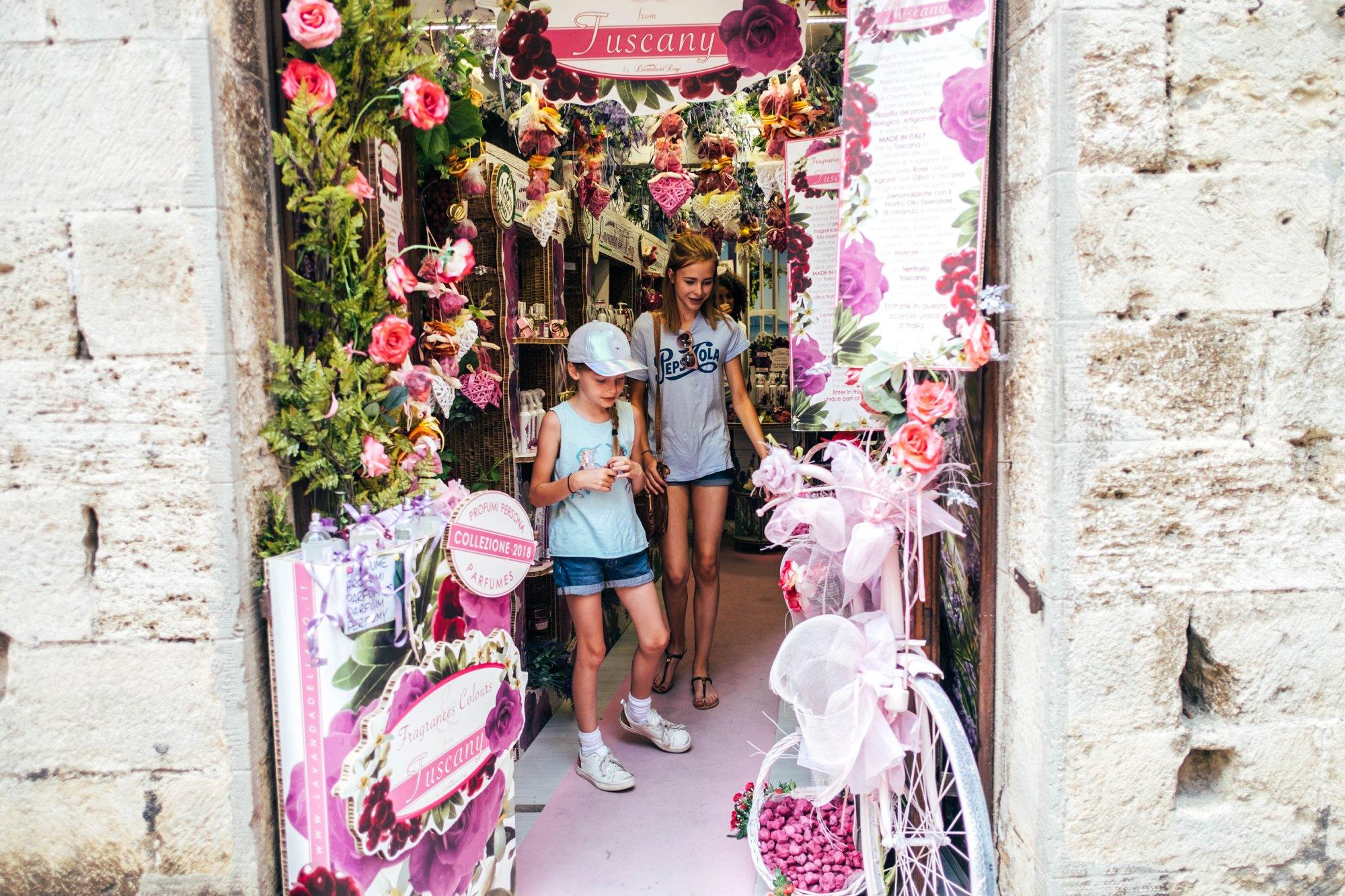 Girls in pink shop St Gimignano Tuscany Essex Documentary Travel Wedding Photographer