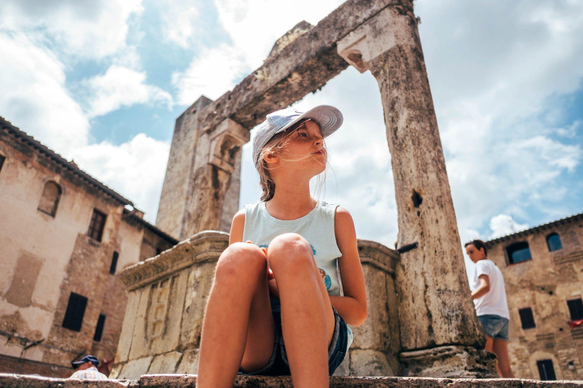Little girl by well St Gimignano Tuscany Essex Documentary Wedding Travel Photographer
