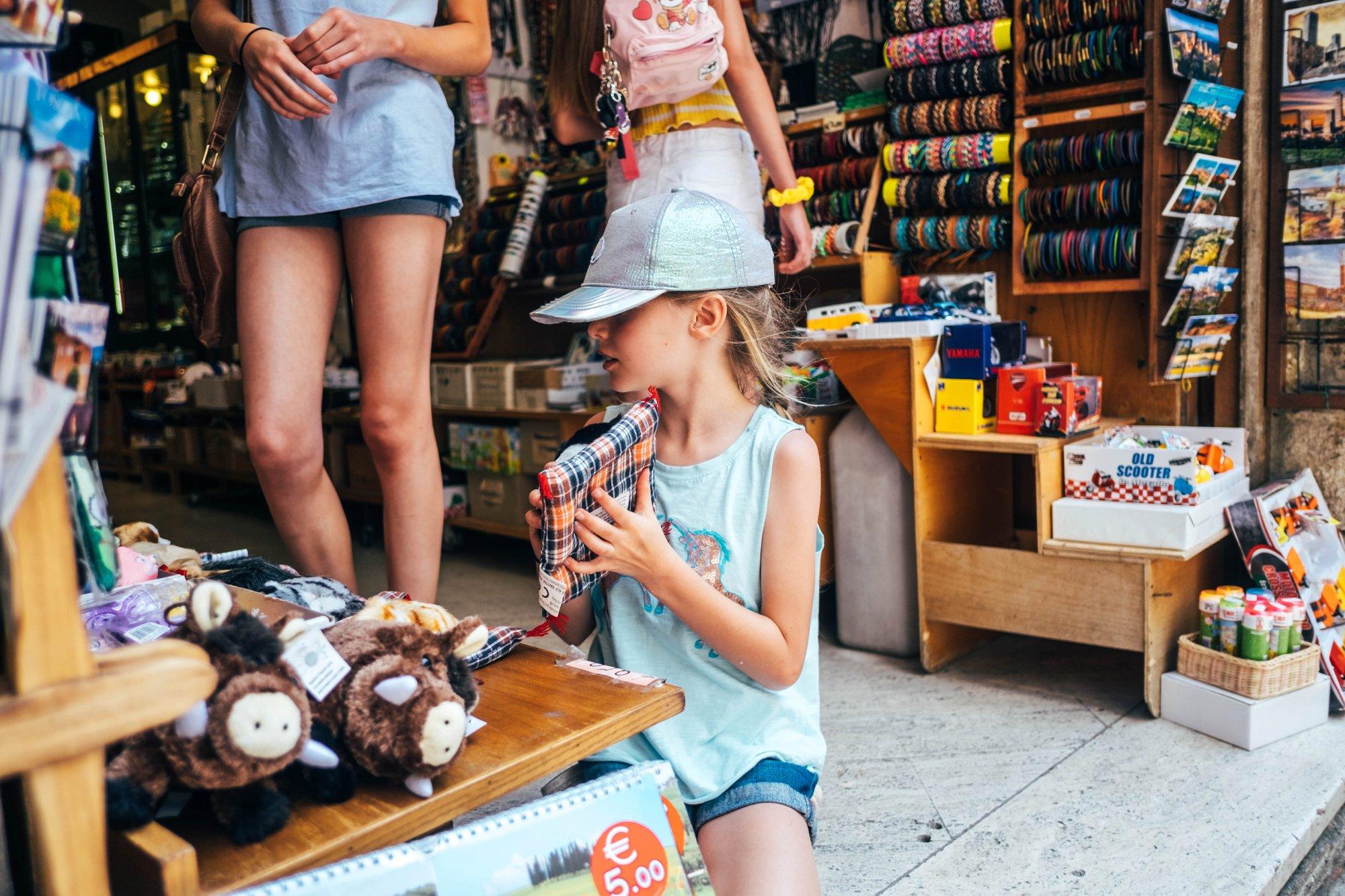 Little girl in shop St Gimignano Tuscany Essex Documentary Wedding Travel photographer