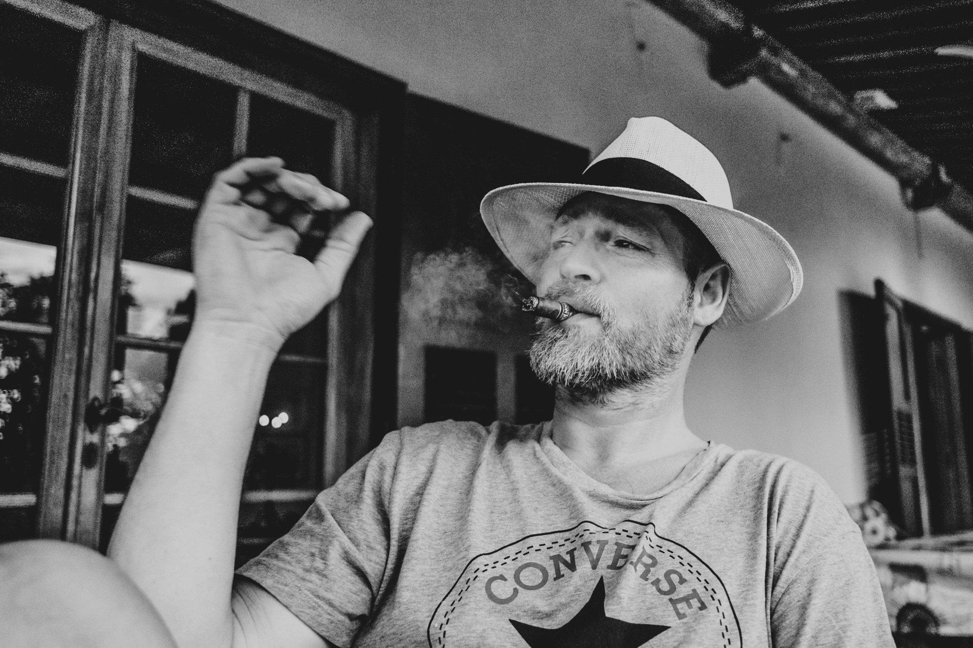 Man in hat smokes cigar Essex Documentary Travel Wedding Family Photographer