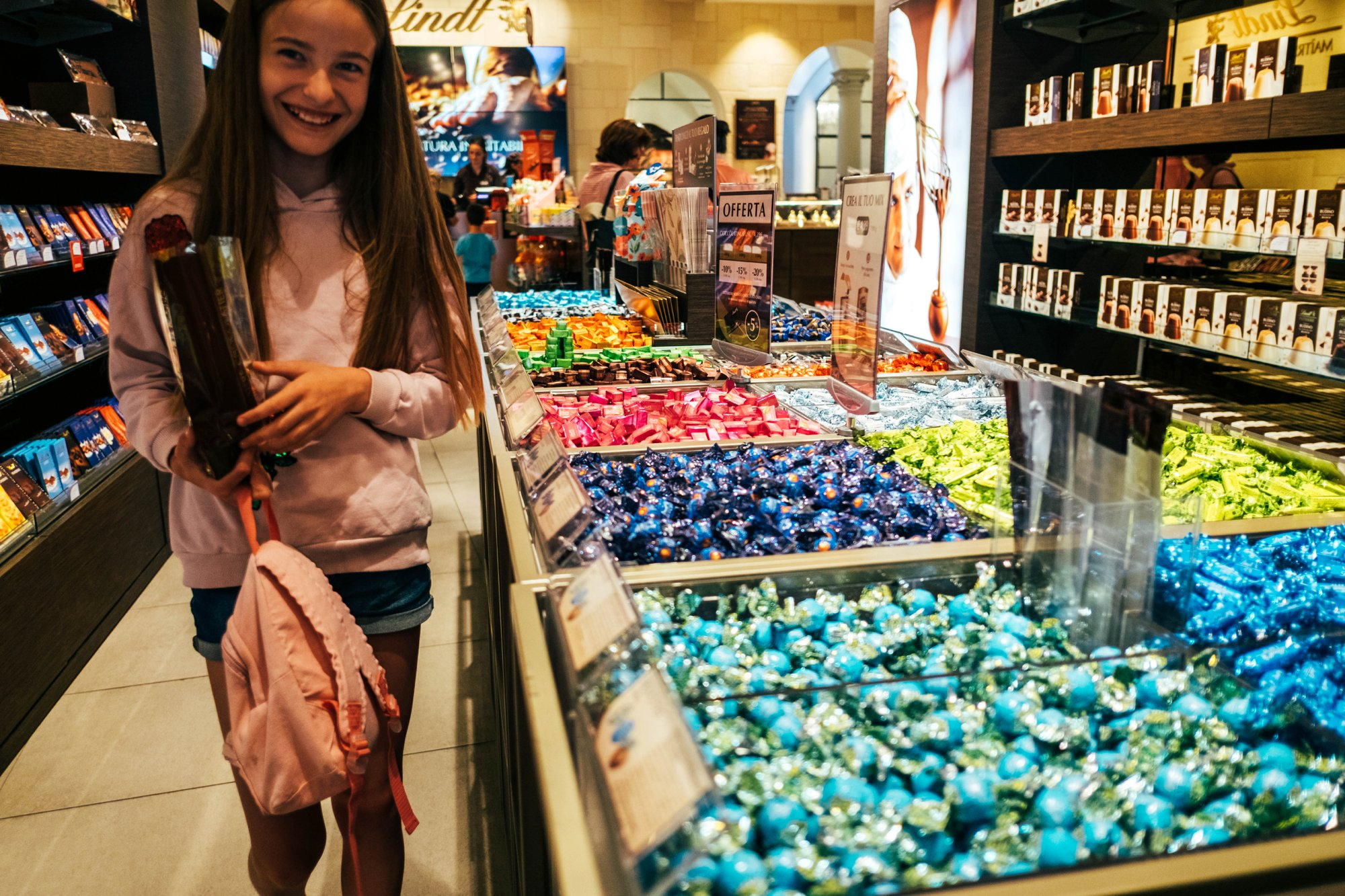 Girl in Lindt Shop Florence Documentary Wedding Travel Photographer