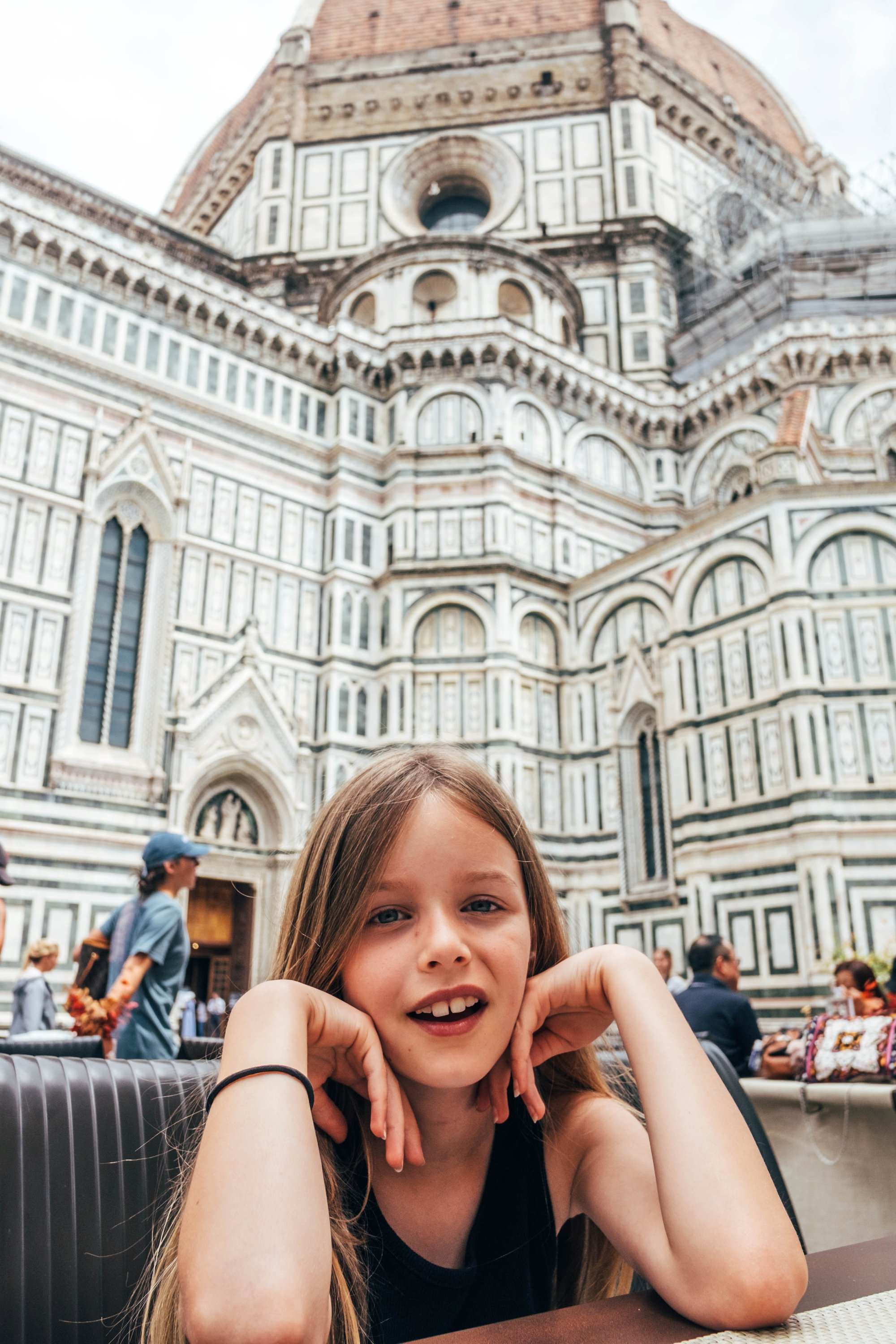 Little girl sits outside the Duomo Florence Italy Essex Documentary Wedding Travel Family Photographer