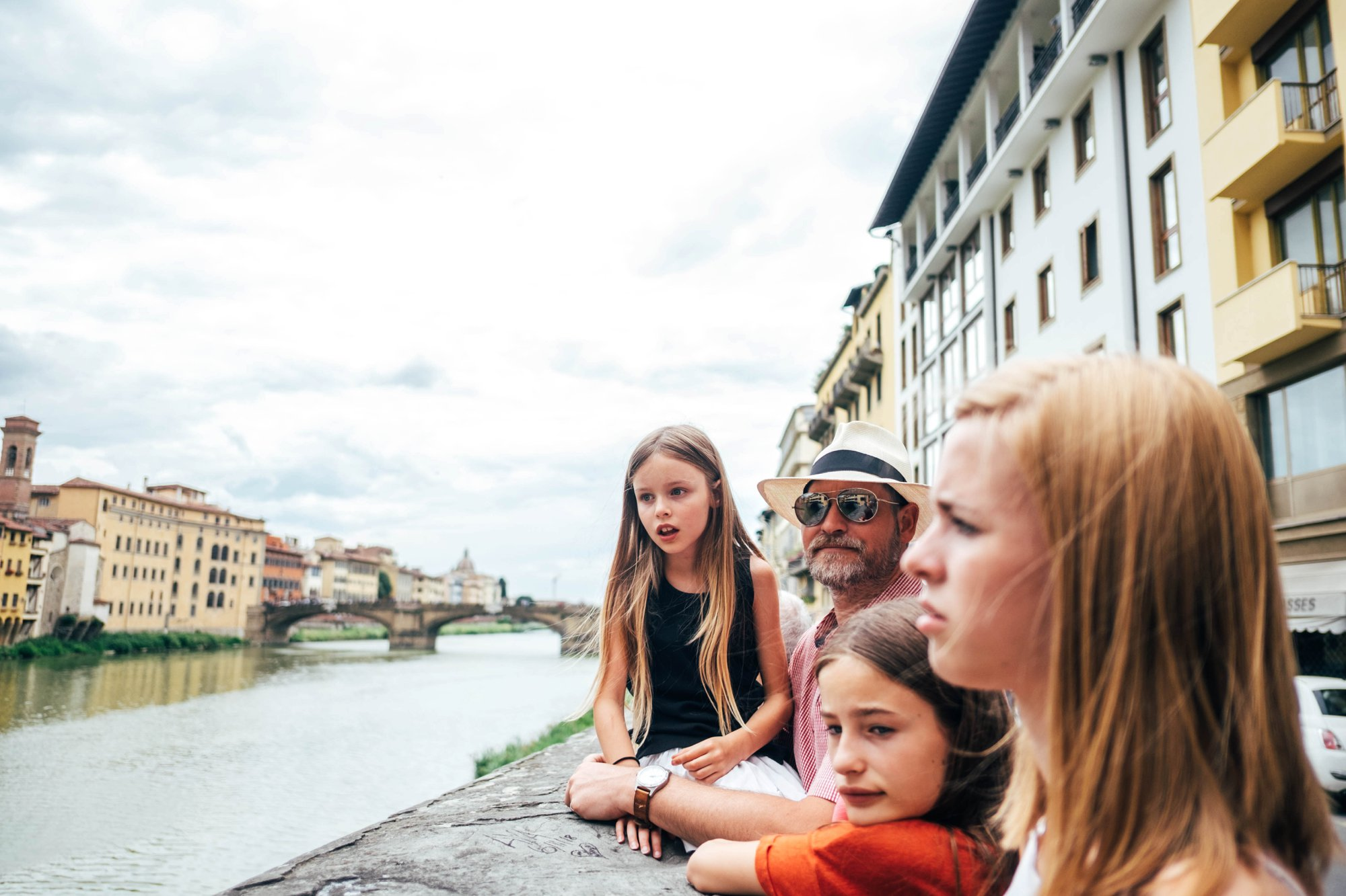 Family on the banks of the Arno Florence Essex Documentary Travel Photographer