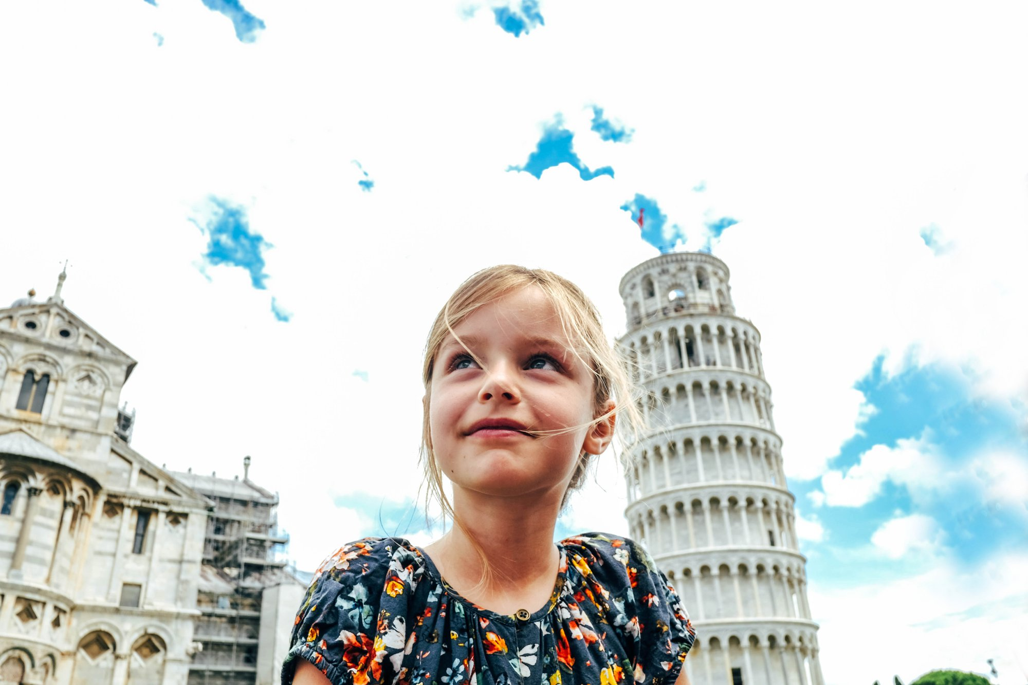 Little girl sits in front of Leaning Tower of Pisa Essex Documentary Wedding Travel Photographer