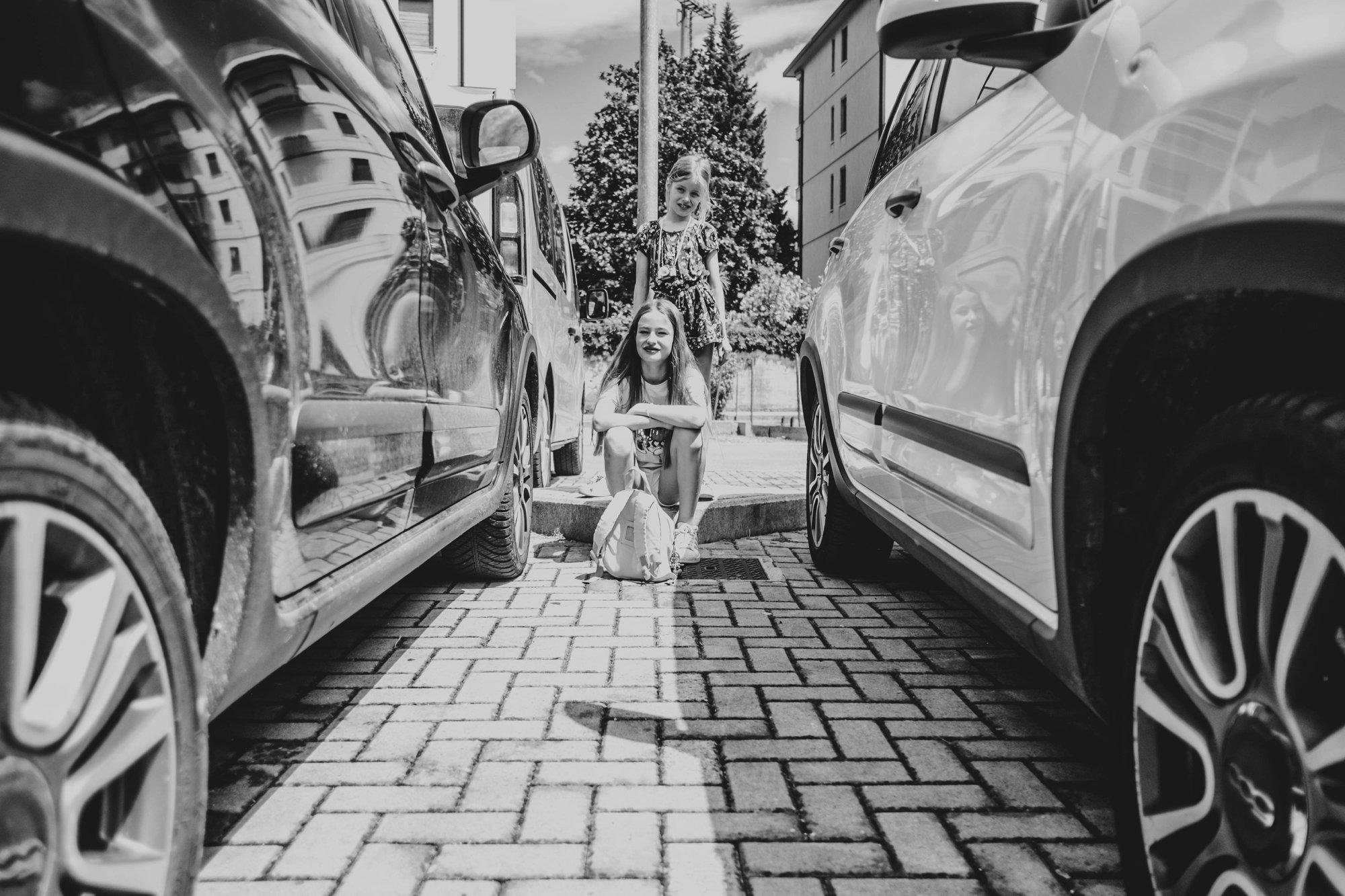 Tween girl in car park in Pisa Essex Documentary Travel Wedding Photographer