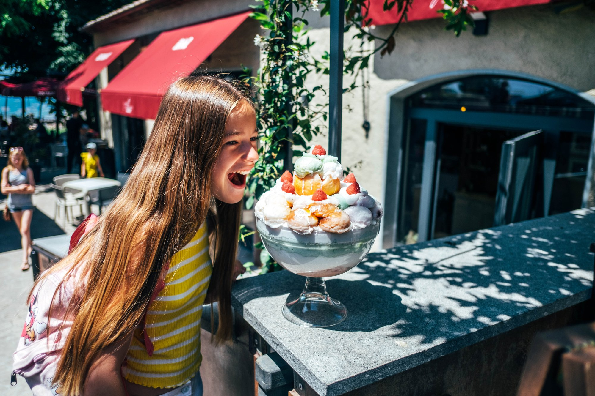 Girl and big ice cream Volterra Tuscany