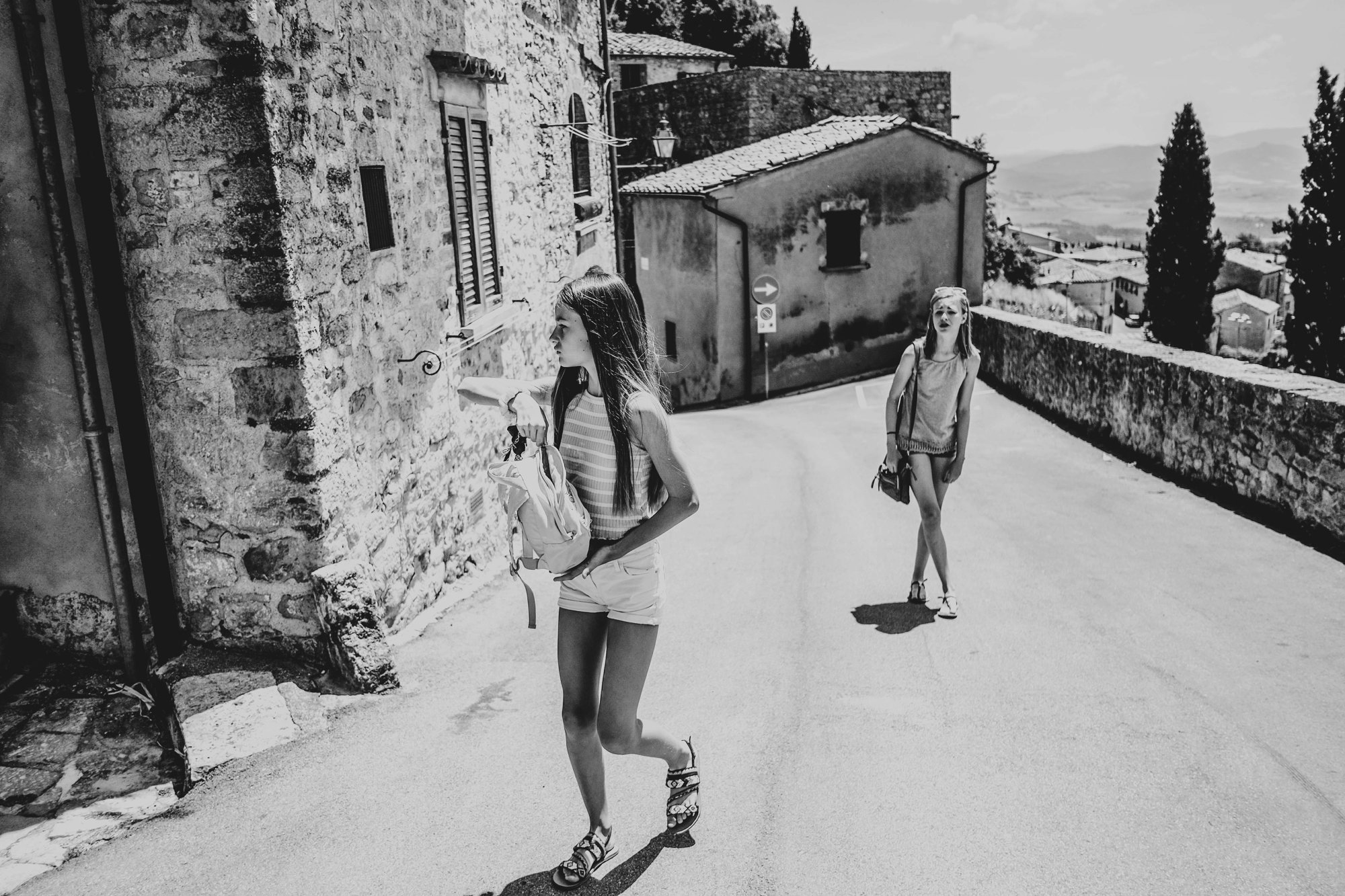 Two sisters in streets of Volterra Tuscany Essex Documentary Travel Family Photographer