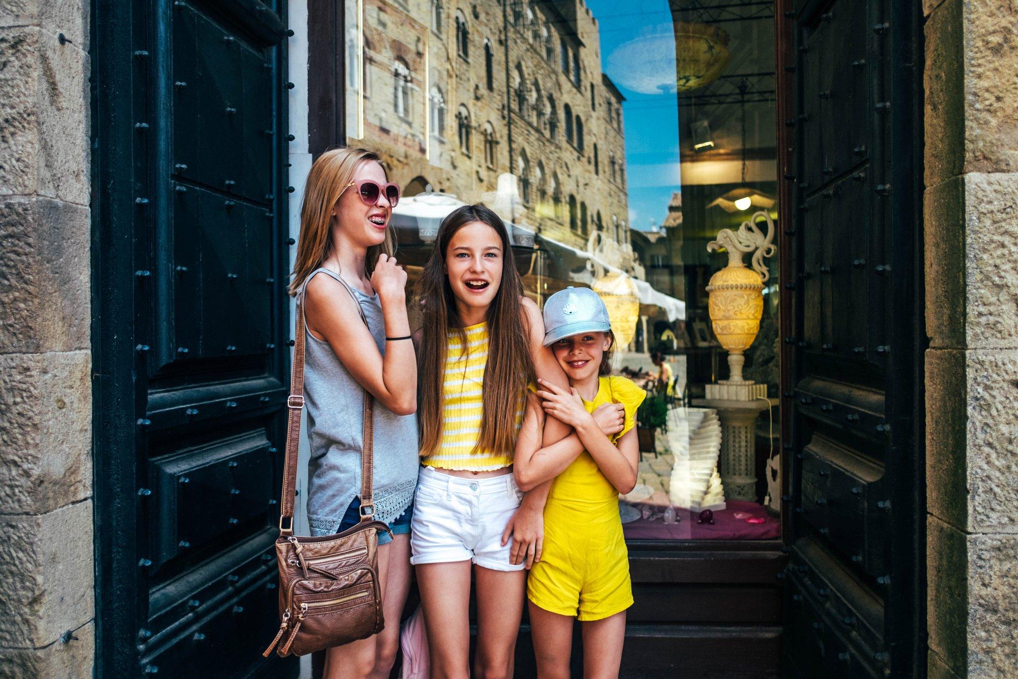 Three sister in doorway Volterra Tuscany Essex Documentary Travel Family Photographer