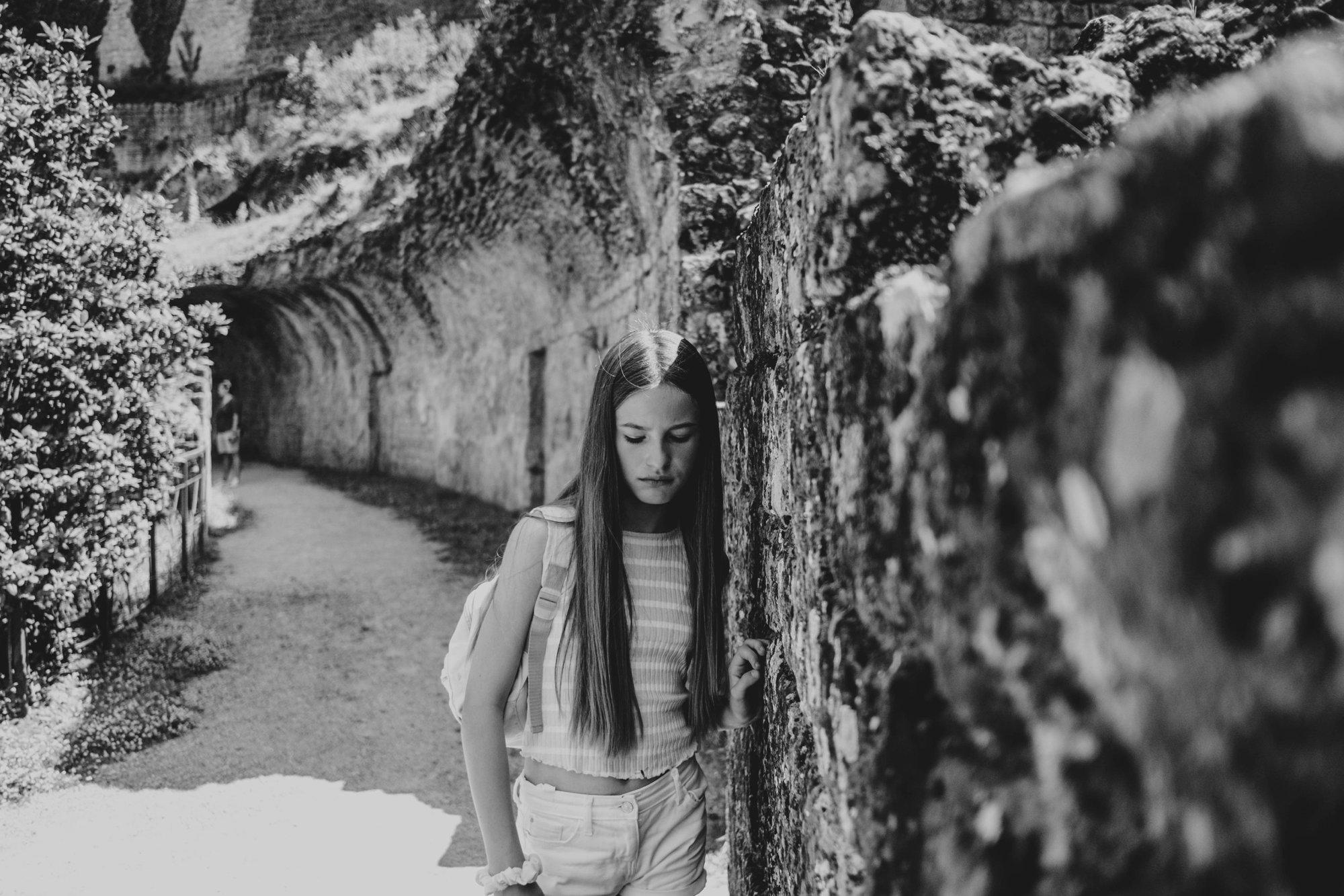 Tween girl in Roman Ruins Volterra Essex Documentary Travel Family Photographer