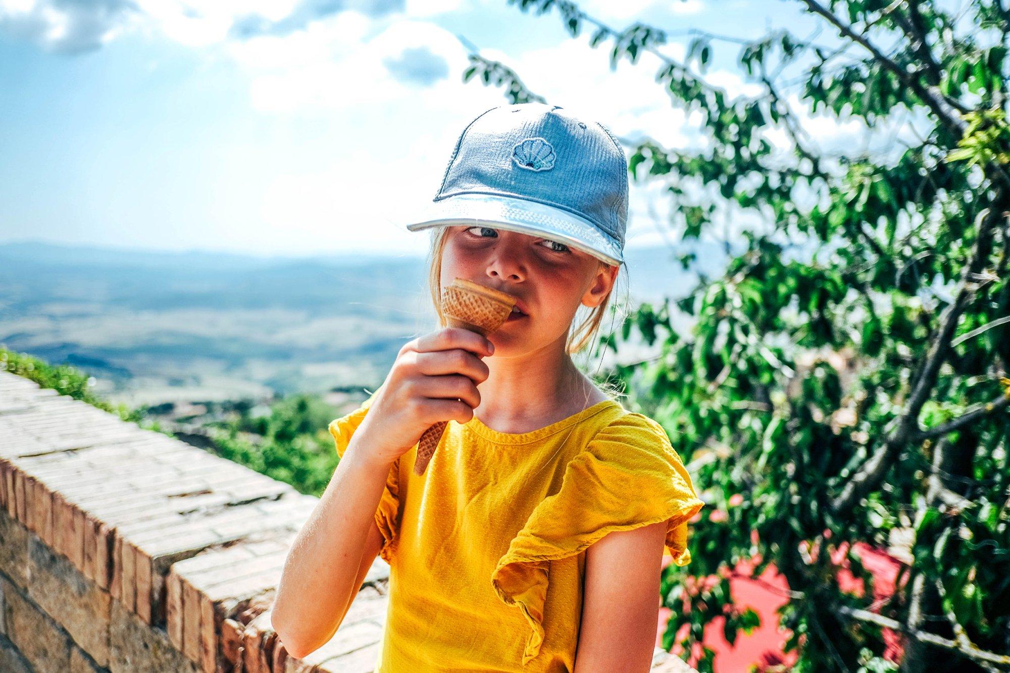 Little girl eats Ice Cream Volterra Tuscany Essex Documentary Travel Family Photographer