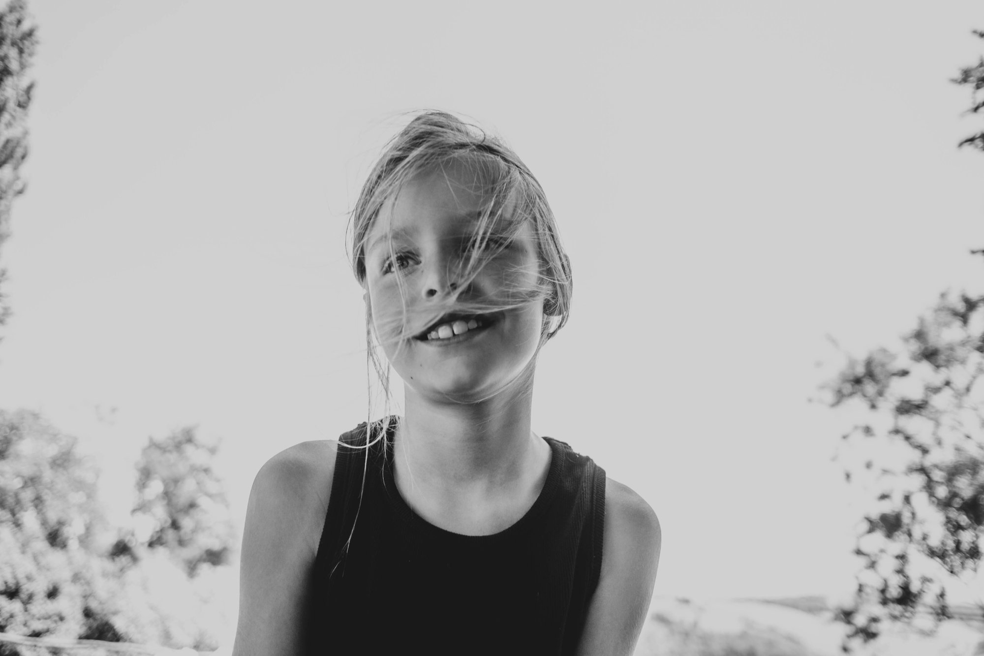 little girl with wind blown hair in Tuscany Essex documentary family travel photographer