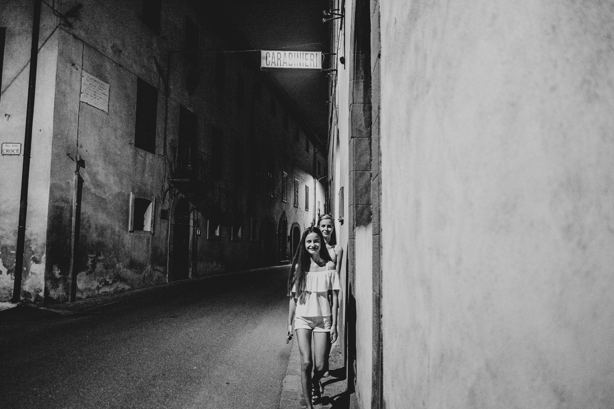 Two sisters on Tuscan street at night Essex Documentary Travel family photographer