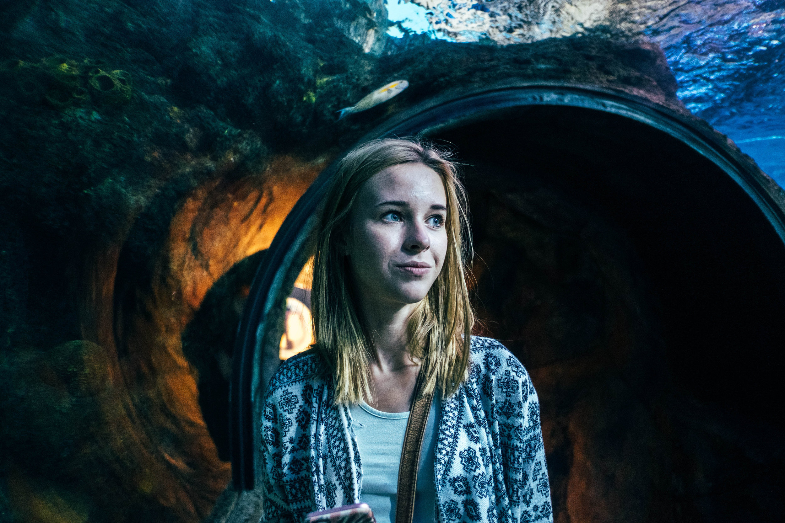 teen girl in underwater tunnel