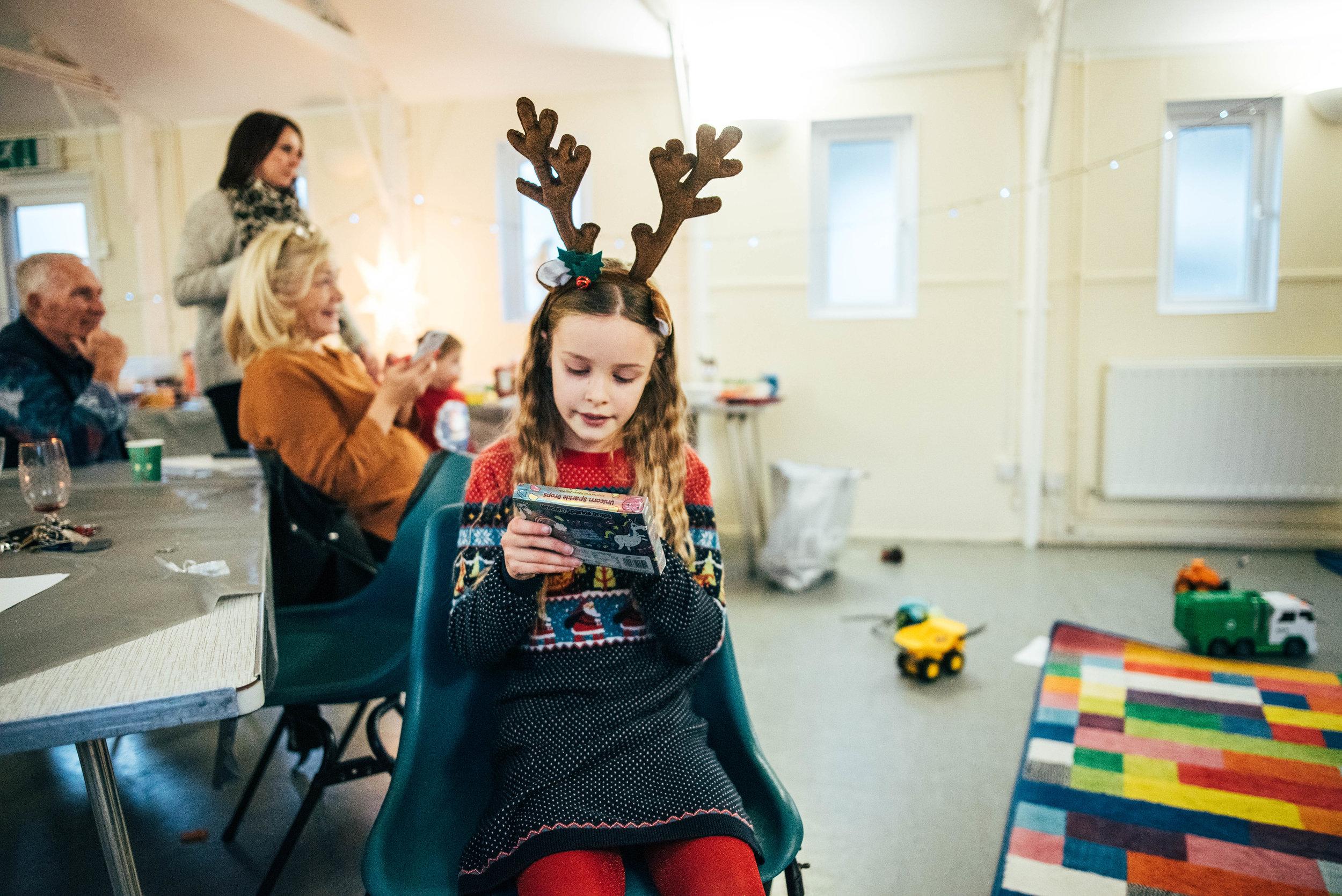 Girl wearing Reindeer antlers Essex Documentary Family Wedding Photographer