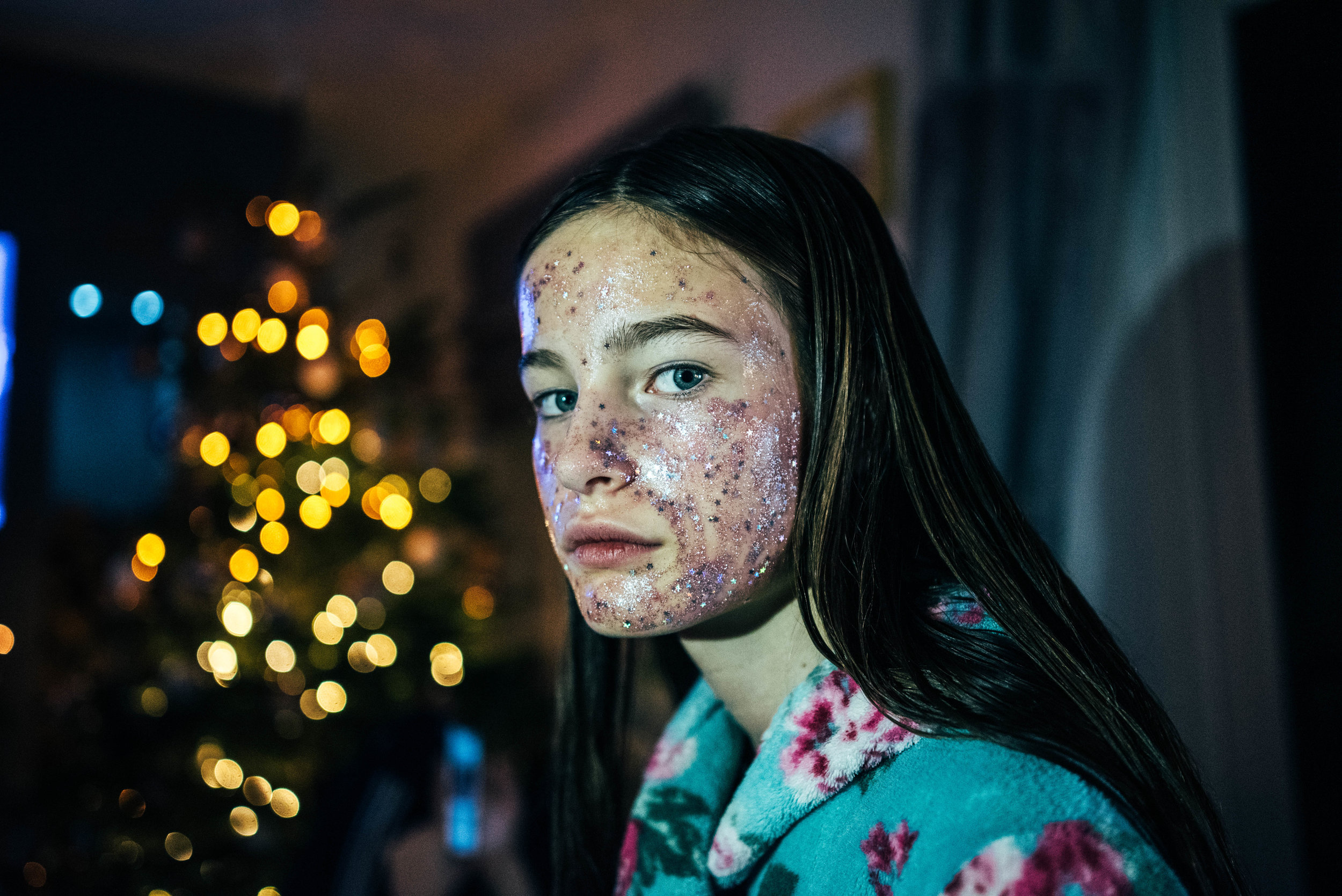 Tween girl can't smile in glittery face mask Essex Documentary Wedding Family Photographer