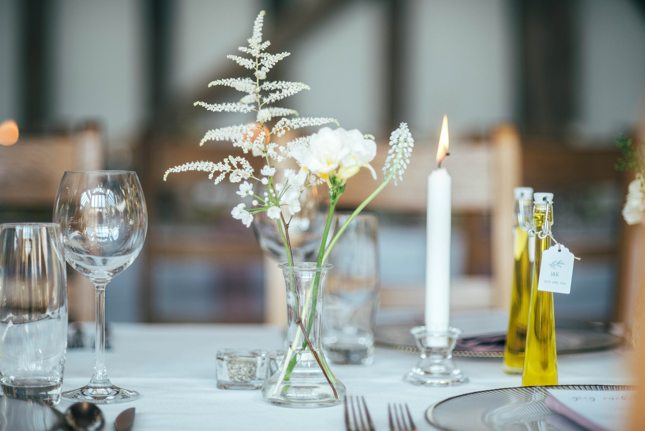 Greens & Whites for an Elegant Easter Wedding at Gate Street Barn with favours of Olive Oil from Bride's family house in France. Bride wears Watters. Essex Documentary Wedding Photographer.