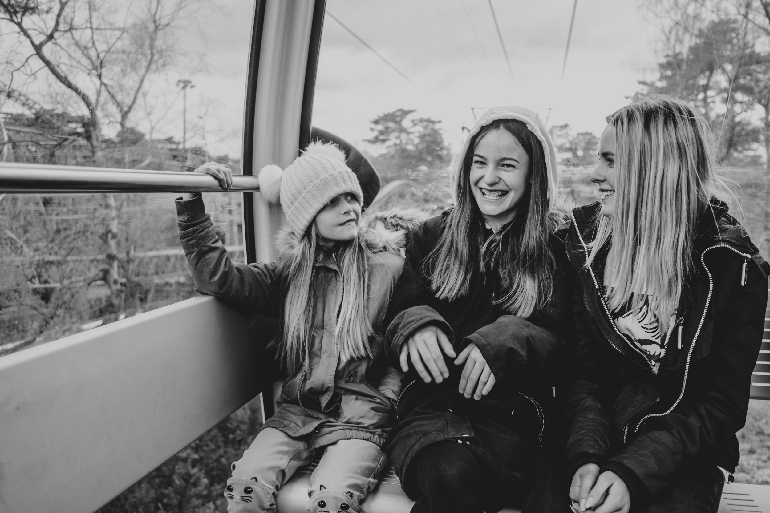 Three sisters in a cable car at Alton Towers Essex Documentary Family Photographer