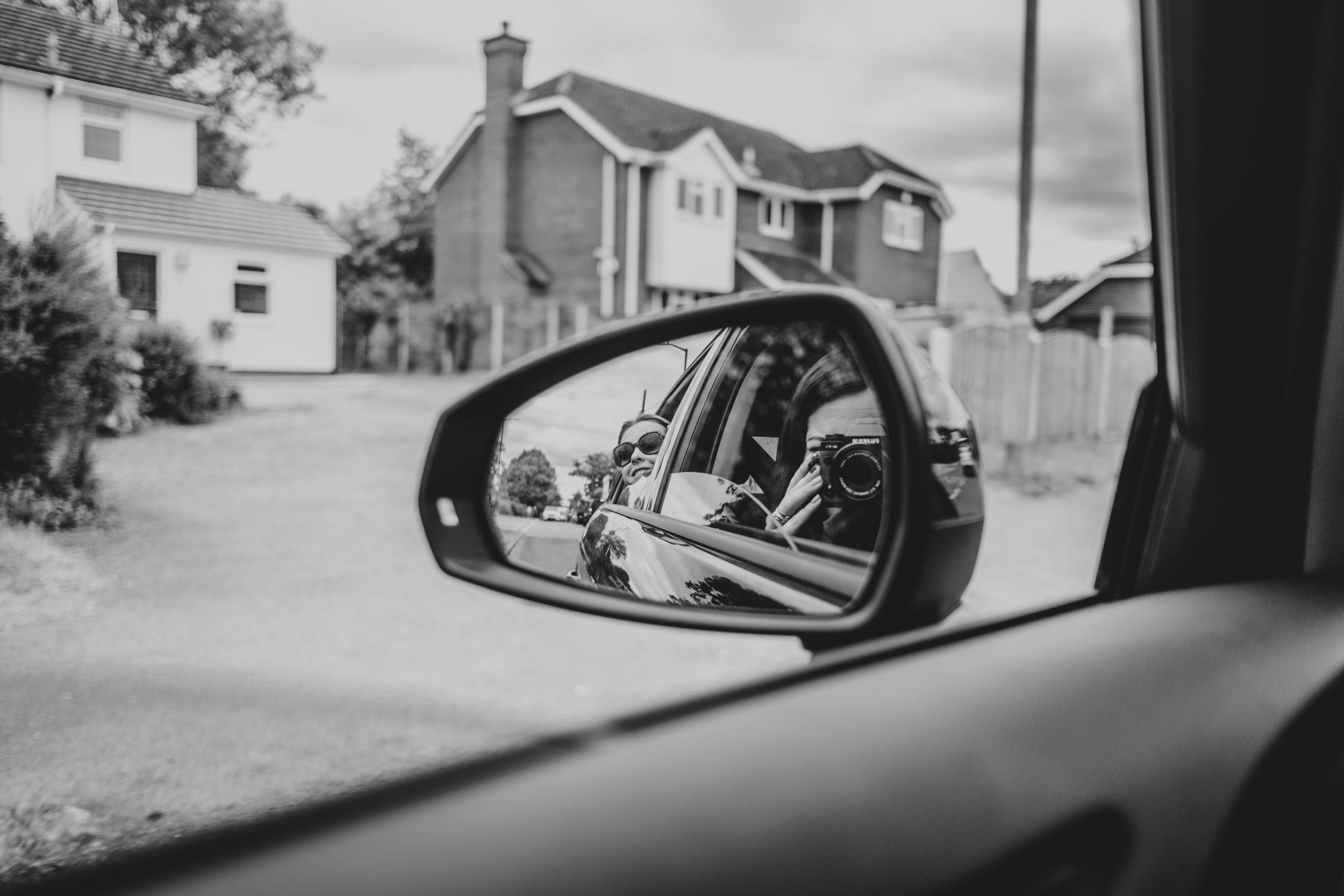 Mum and daughter in wing mirror of car Essex Documentary Family Photographer