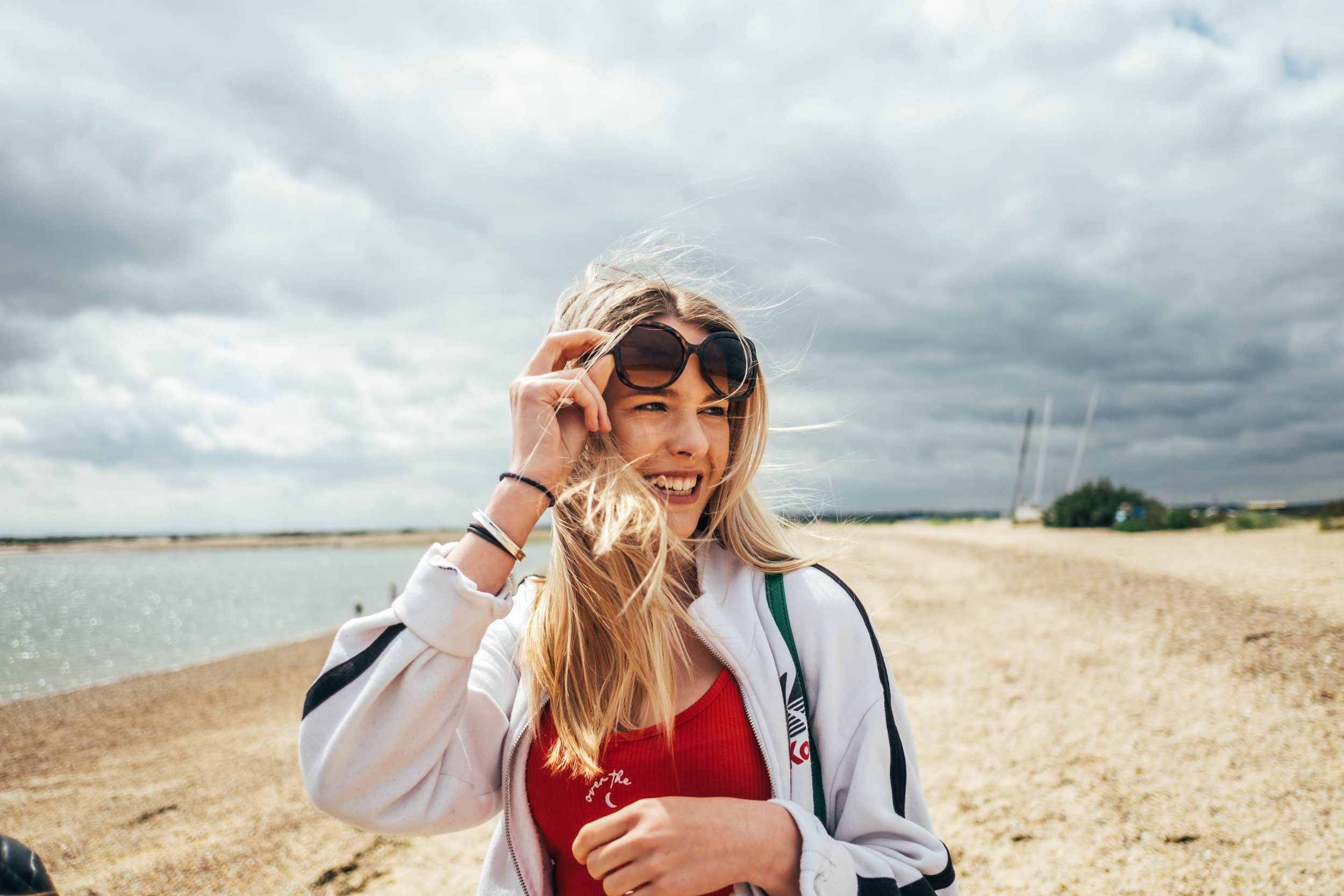 Teen girl on windy beach Essex documentary Family Photographer