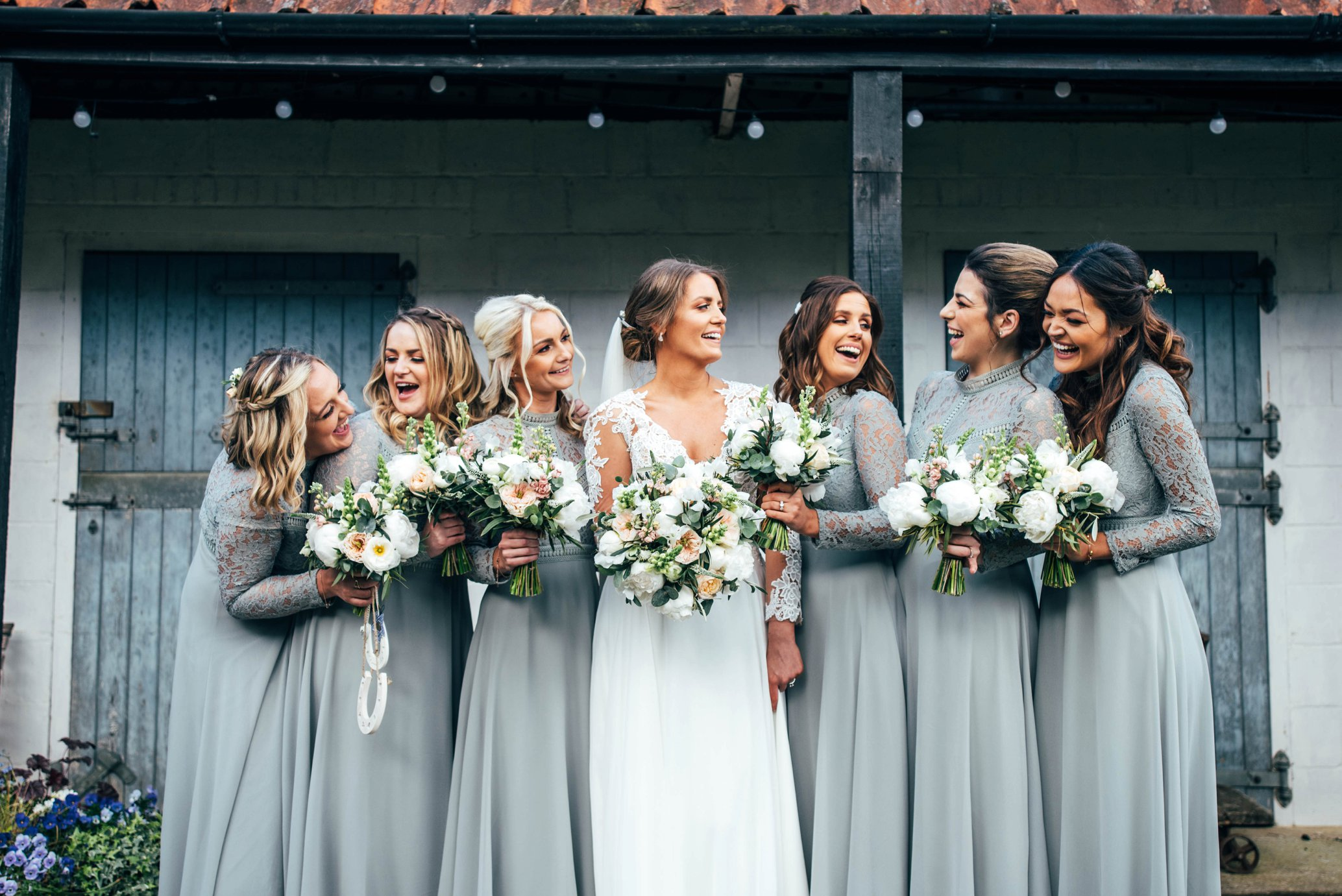 A gorgeous botanical inspired spring barn wedding with bridesmaids in light blue.  The Granary Estates, Woodditton. Essex Documentary Wedding Photographer