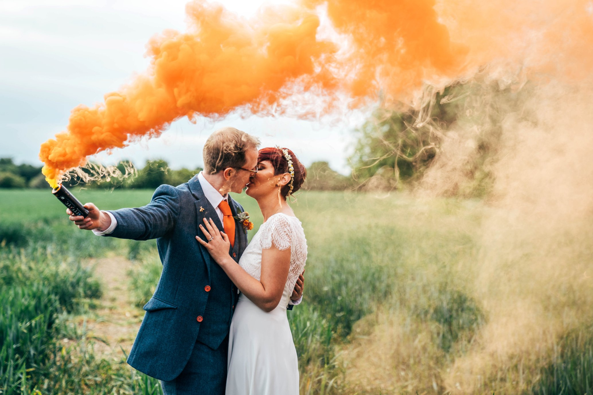 DIY Village Hall Outdoor Wedding Flower Arc Camper Pizza Van Orange smoke bombs dip dye wedding dress Essex Documentary Wedding Photographer