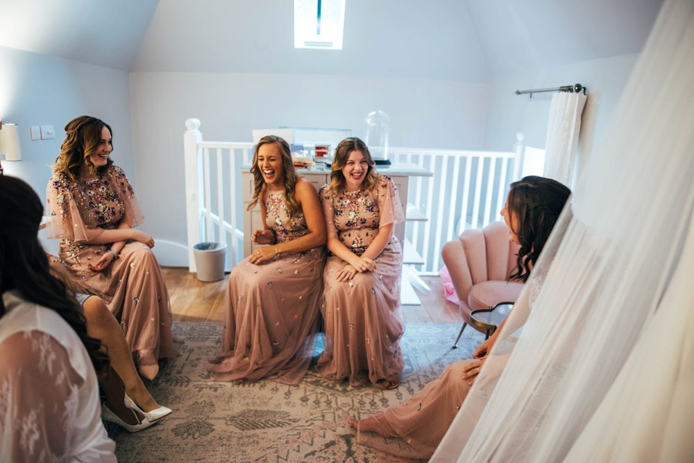 Travel Inspired Summer Wedding at Gaynes Park with Bridesmaids in Boho Floral Pink. Three Flowers Photography