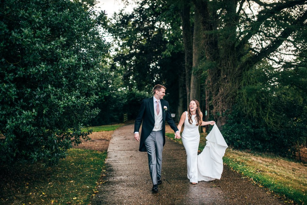 Travel Inspired Summer Wedding at Gaynes Park with Bridesmaids in Boho Floral Pink. Essex Documentary Wedding Photographer