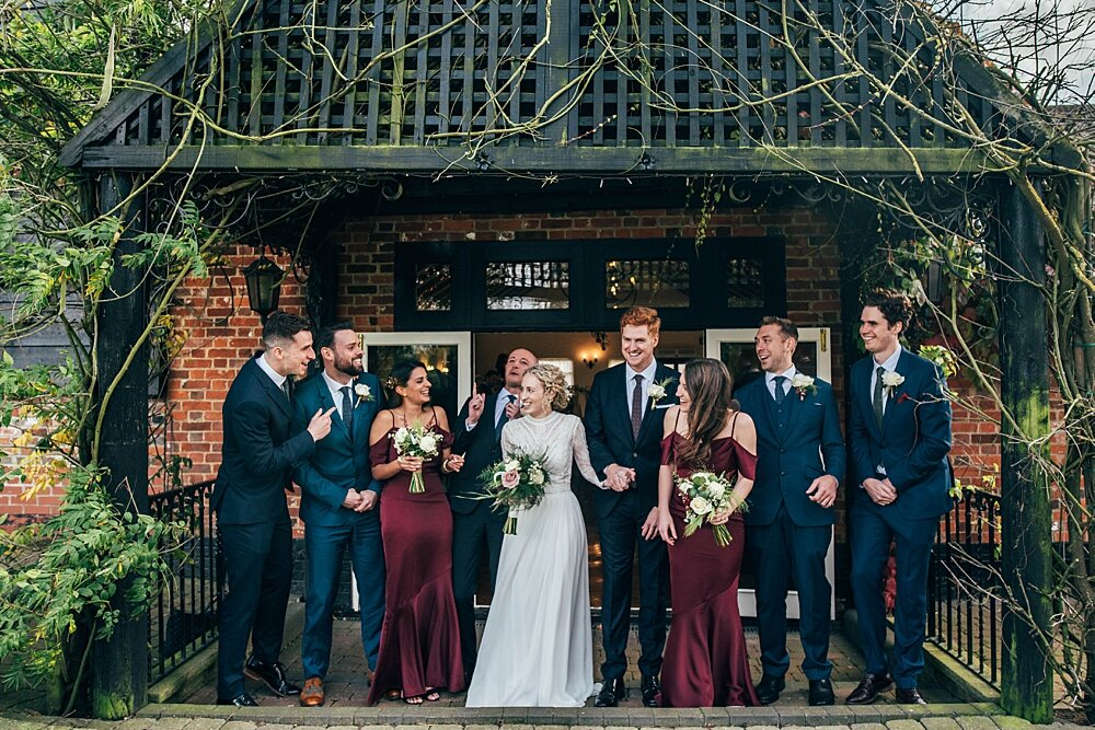 Autumn barn wedding at Crondon Park with rich reds and an ethereal Pronovias gown with Game of Throne vibes! Essex Documentary Wedding Photographer