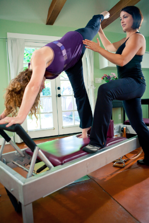 Exercise on the Pilates Reformer taught by Pilates with Paige