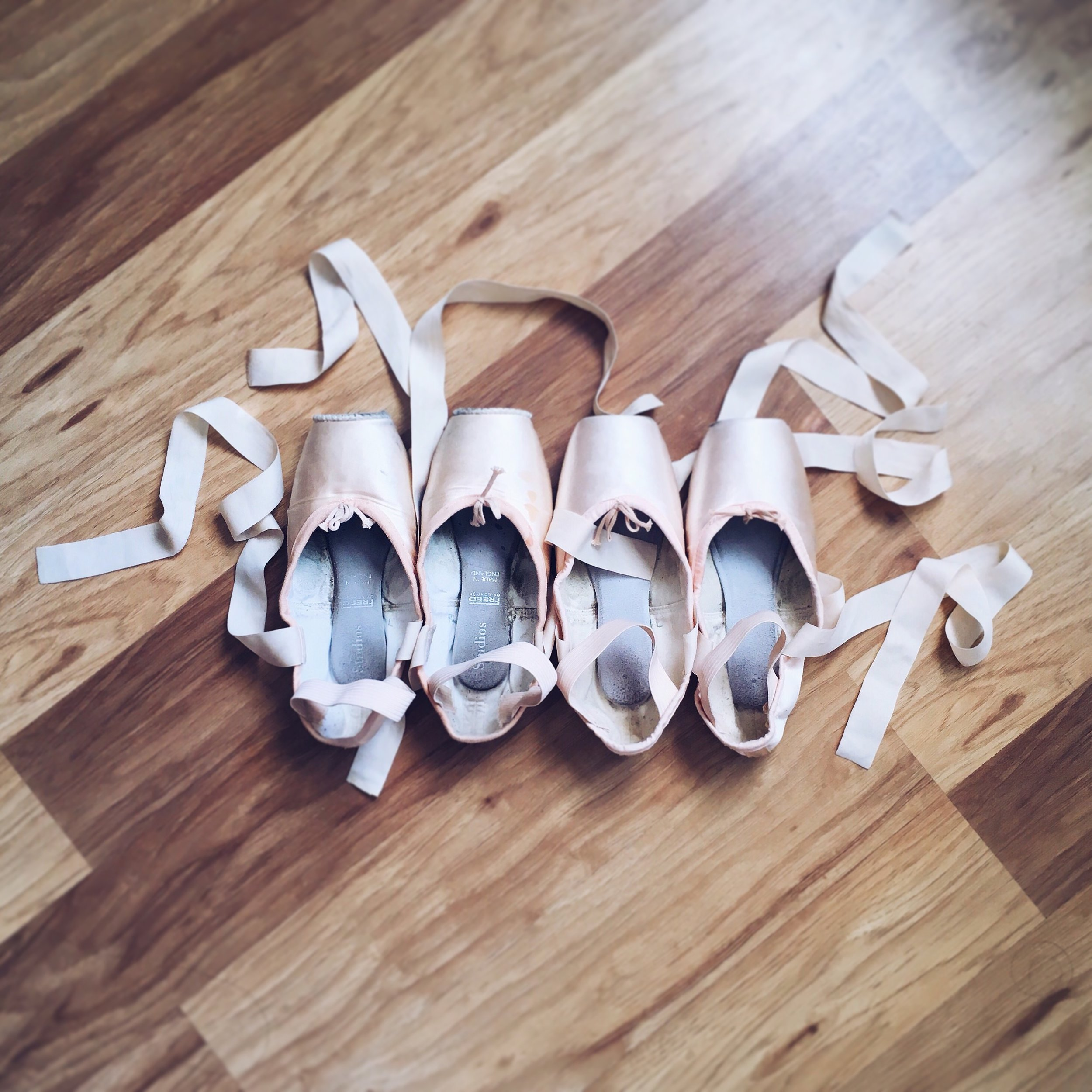"""Solo Artist Stephanie Joe explains: """"Here you can see two different pointe shoe brands I've been wearing - the shoes on the left have darning around the edge of the platform, and the shoes on the right are new and haven't been darned yet!"""""""
