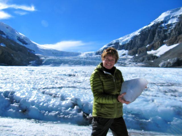 Paula at Columbia Icefield with a chunk of glacier in her hands BRR!