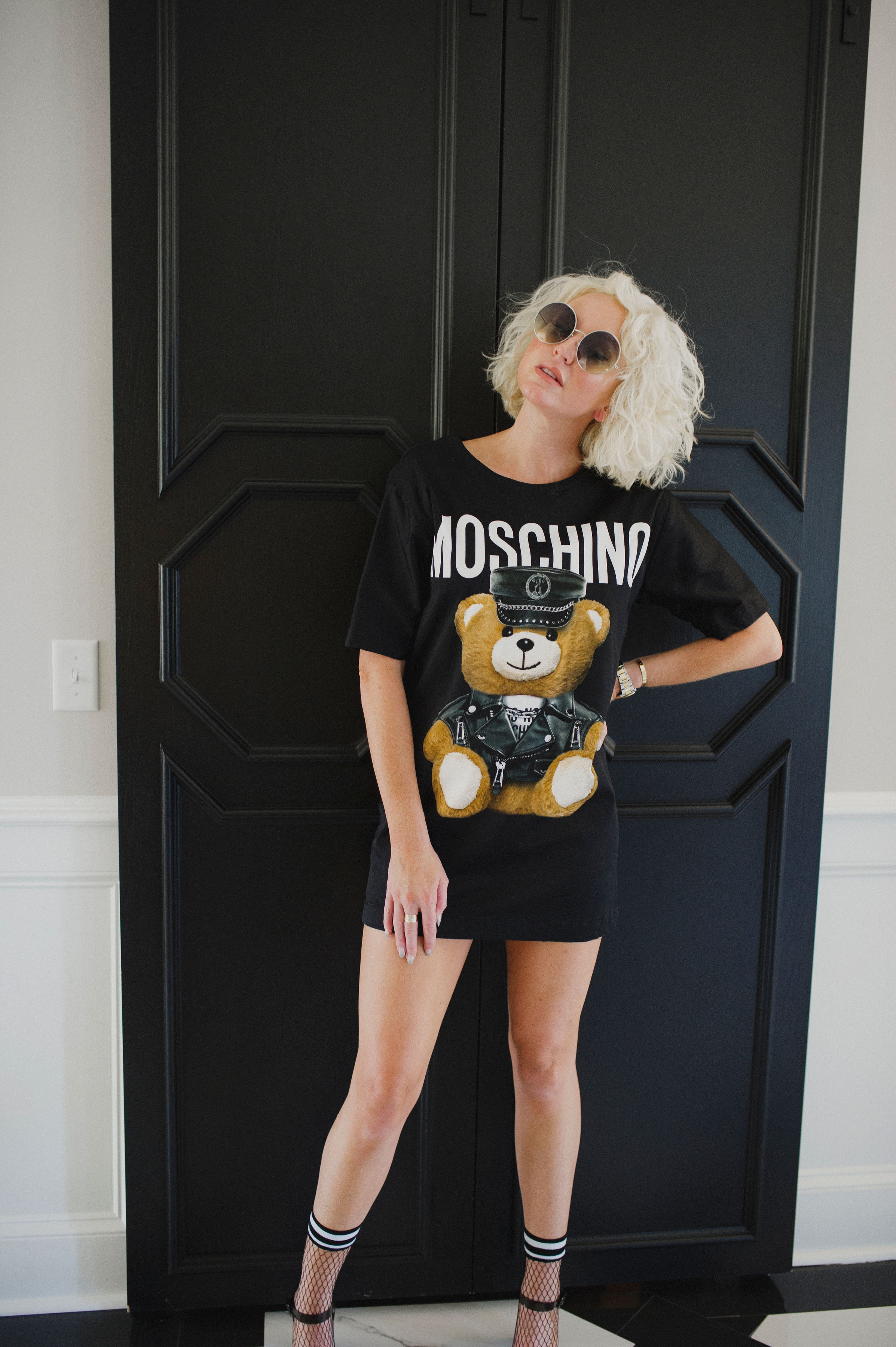 "This Moschino t-shirt dress was captured while on a hunt in New York. - Chris found it randomly on a rack of designer pieces at Century 21. He picked up and said, ""Lyv this looks weird and right up your alley."" And I said, ""IT IS! I loved it.""At the time I didn't have any Moschino pieces in my closest. I had always admired how eccentric Moschino garments can be especially under the direction of their creative director Jeremy Scott. There's an excellent Netflix documentary about him and his journey in the fashion industry and within Moschino."