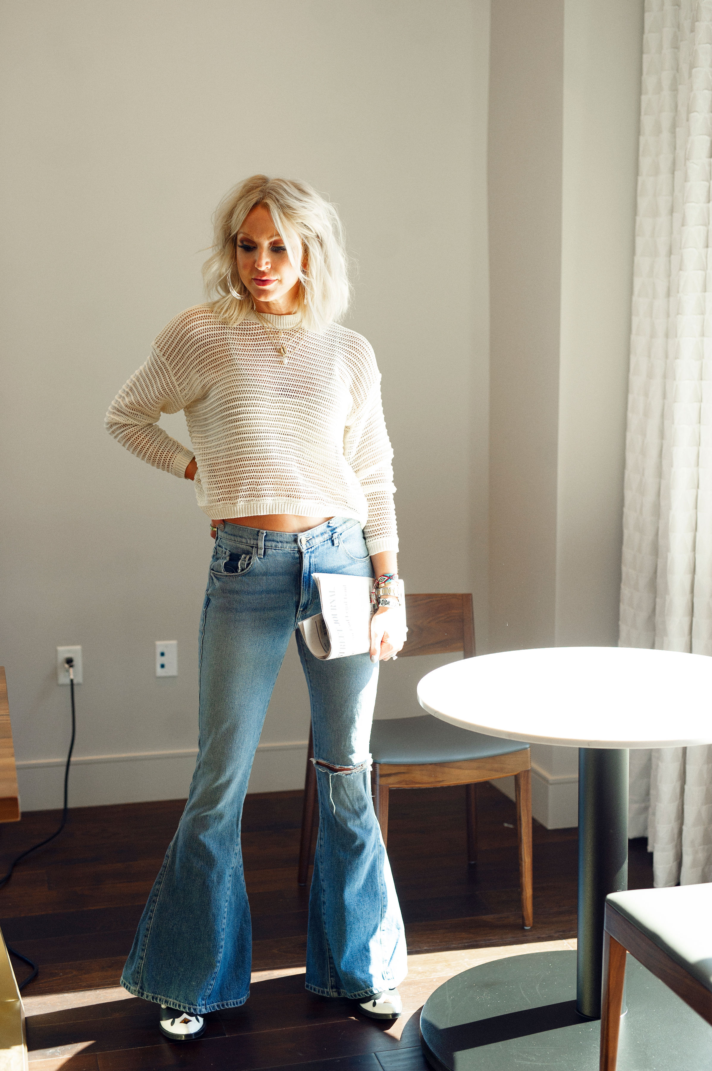 I styled the whole lewk, very easy breezy summer vibe with a pair of bell bottom jeans and cowgirl boots. -