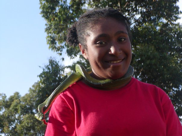 Jean hanging out with a friendly green tree python. Photo: Christy Miller