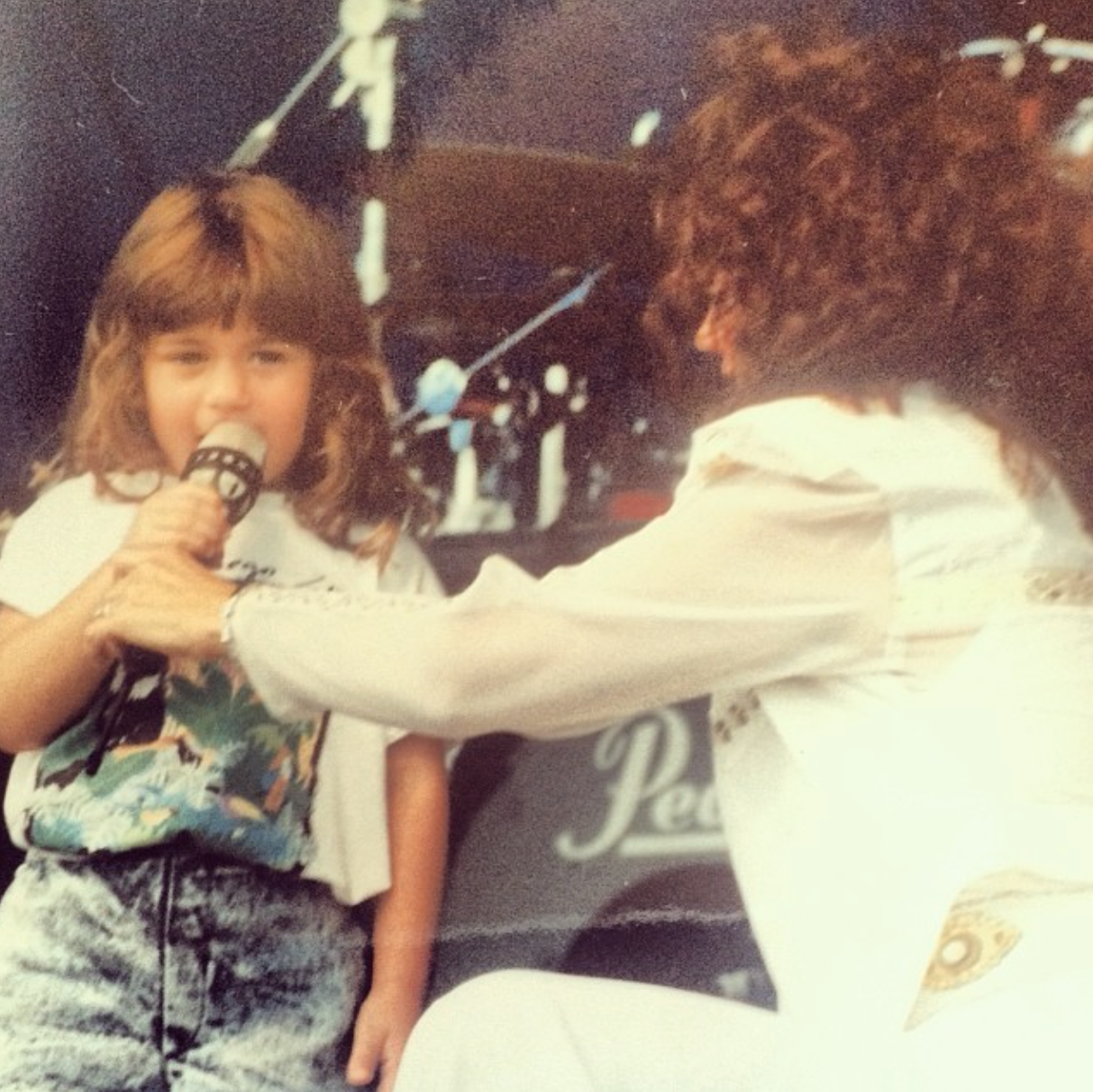 Singing somewhere on tour with momma!