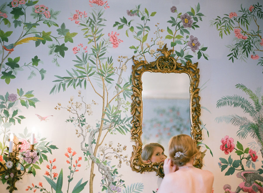 bride getting ready in wallpaper room at Villa Terrace Milwaukee