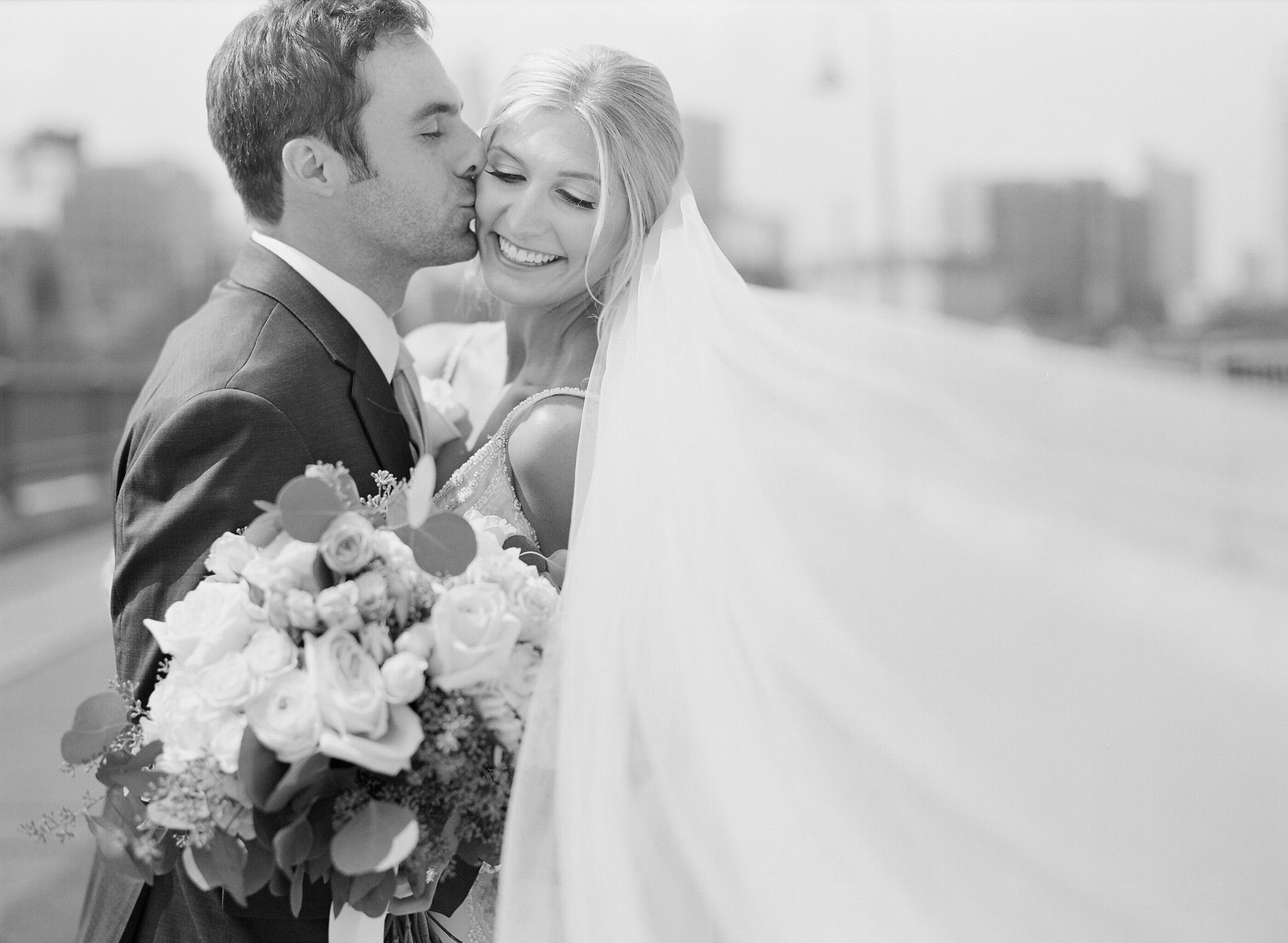 black and white stone arch bridge minneapolis wedding portraits