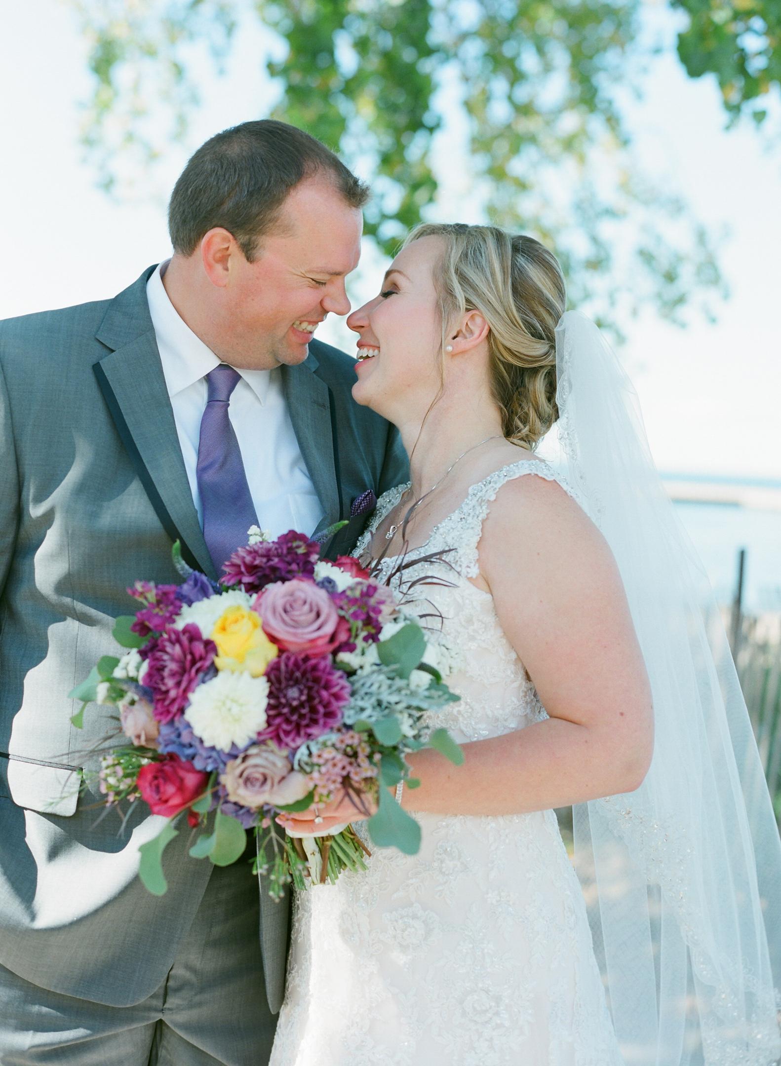 adorable happy bride and groom portrait at murphy park in door county, wi