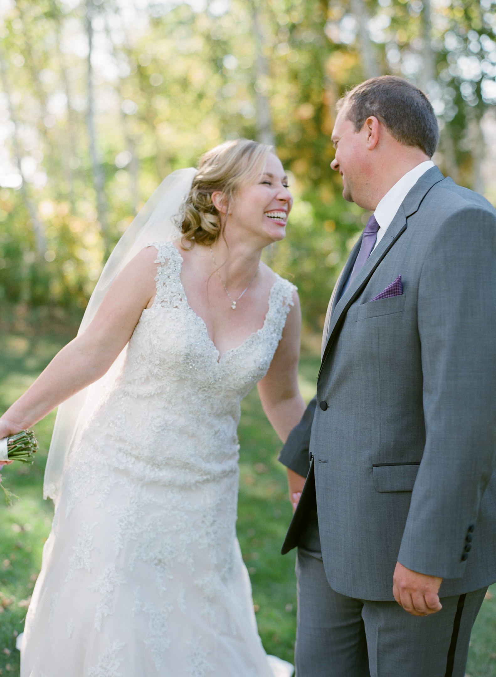 bride and groom laughing at Horseshoe Bay Golf Club wedding reception